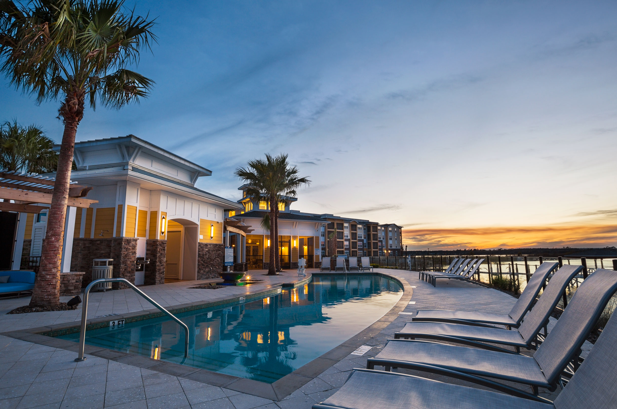 commercial photography image of waterside pool resort