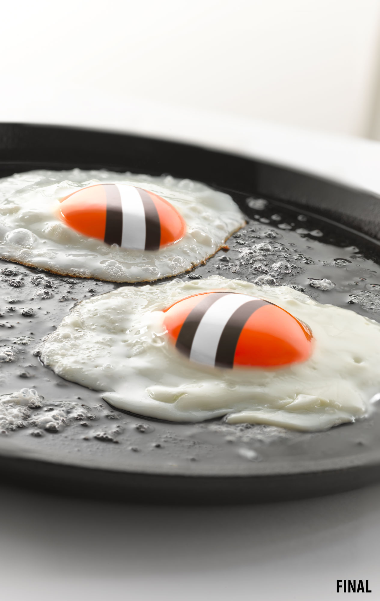 professional composite image of eggs with cleveland browns helmets as yolks