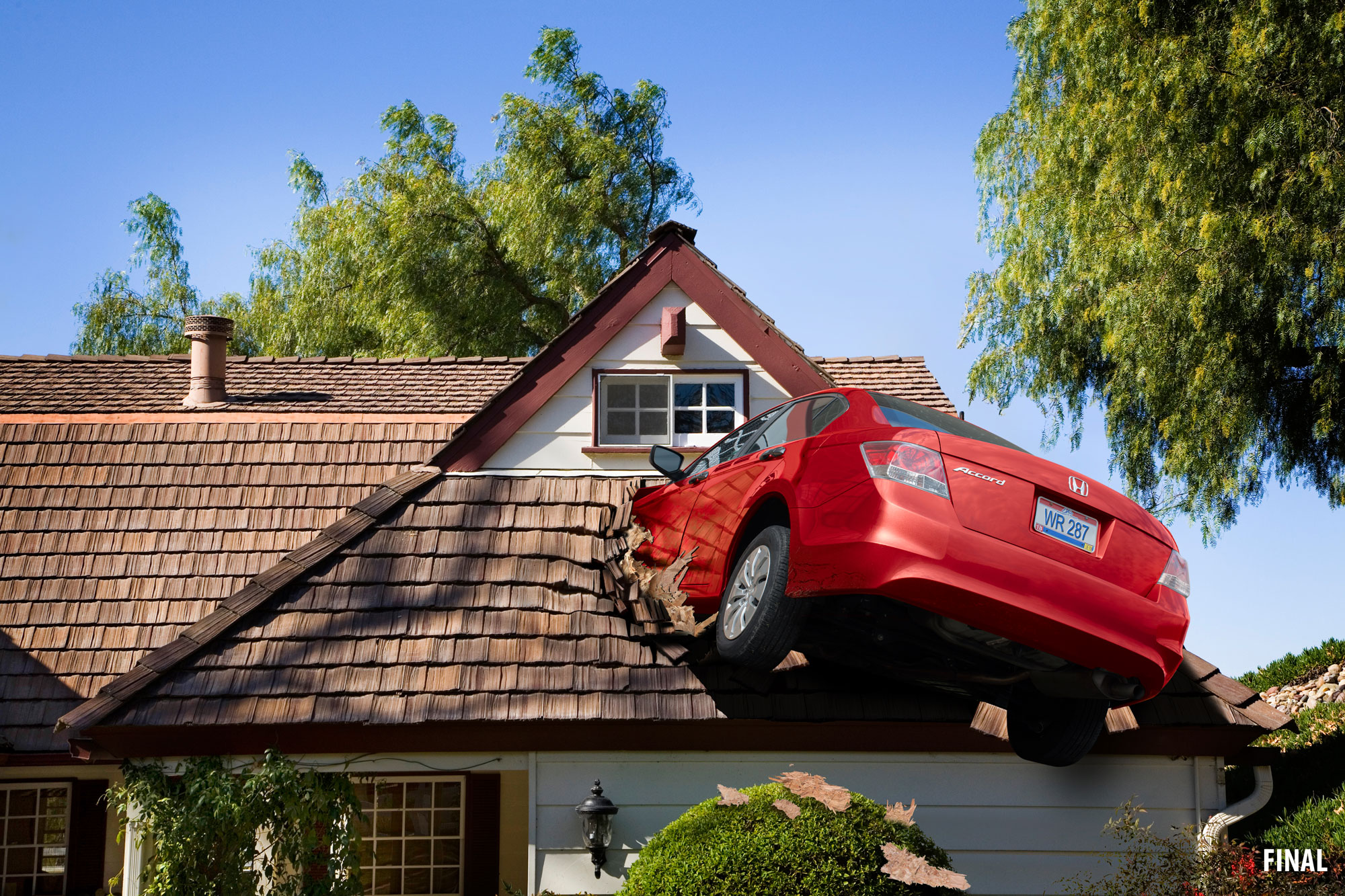 professional composite imagery of car crashing into roof of house