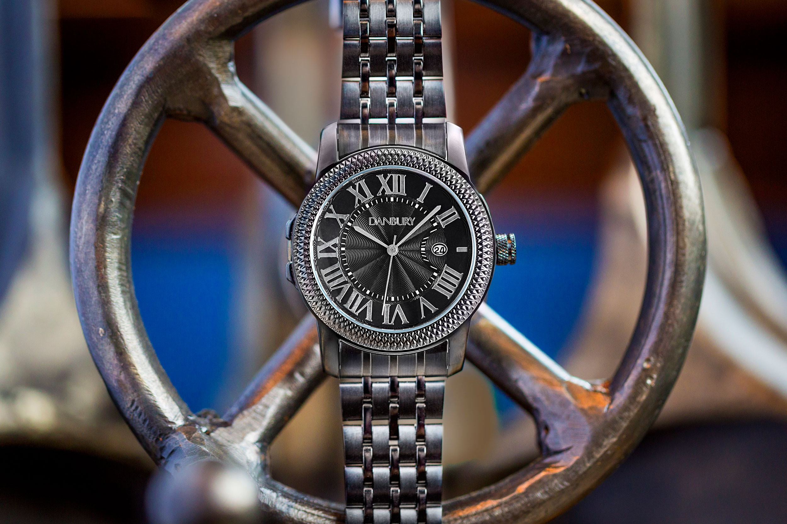 commercial product photography image of watch on steering wheel