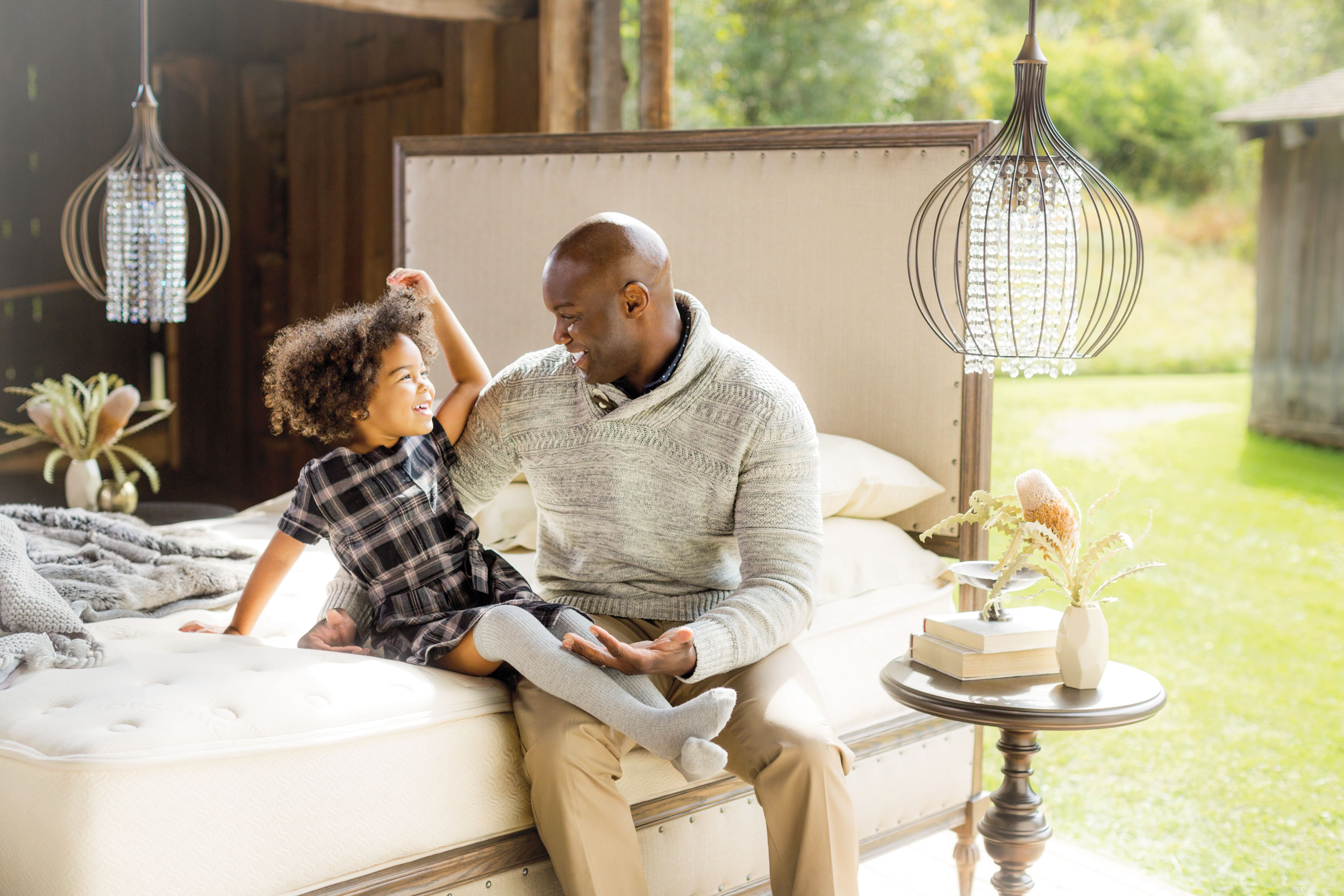 professional commercial photography of father and daughter on furniture