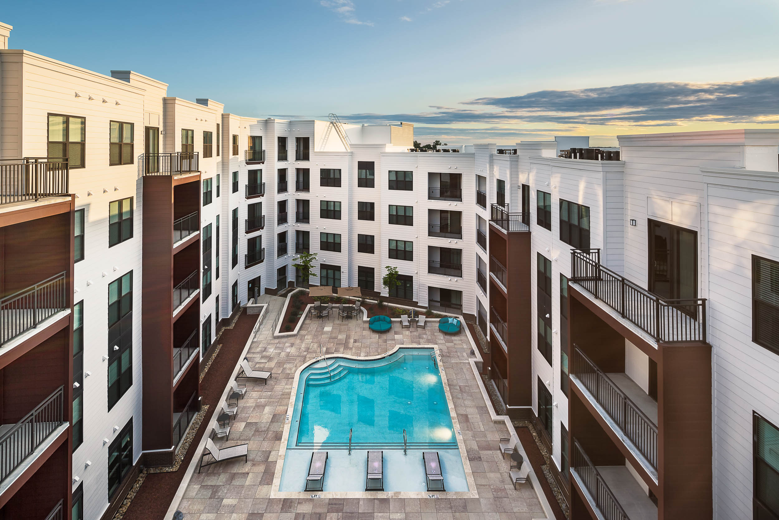 commercial photography image of apartment complex outdoor pool and courtyard