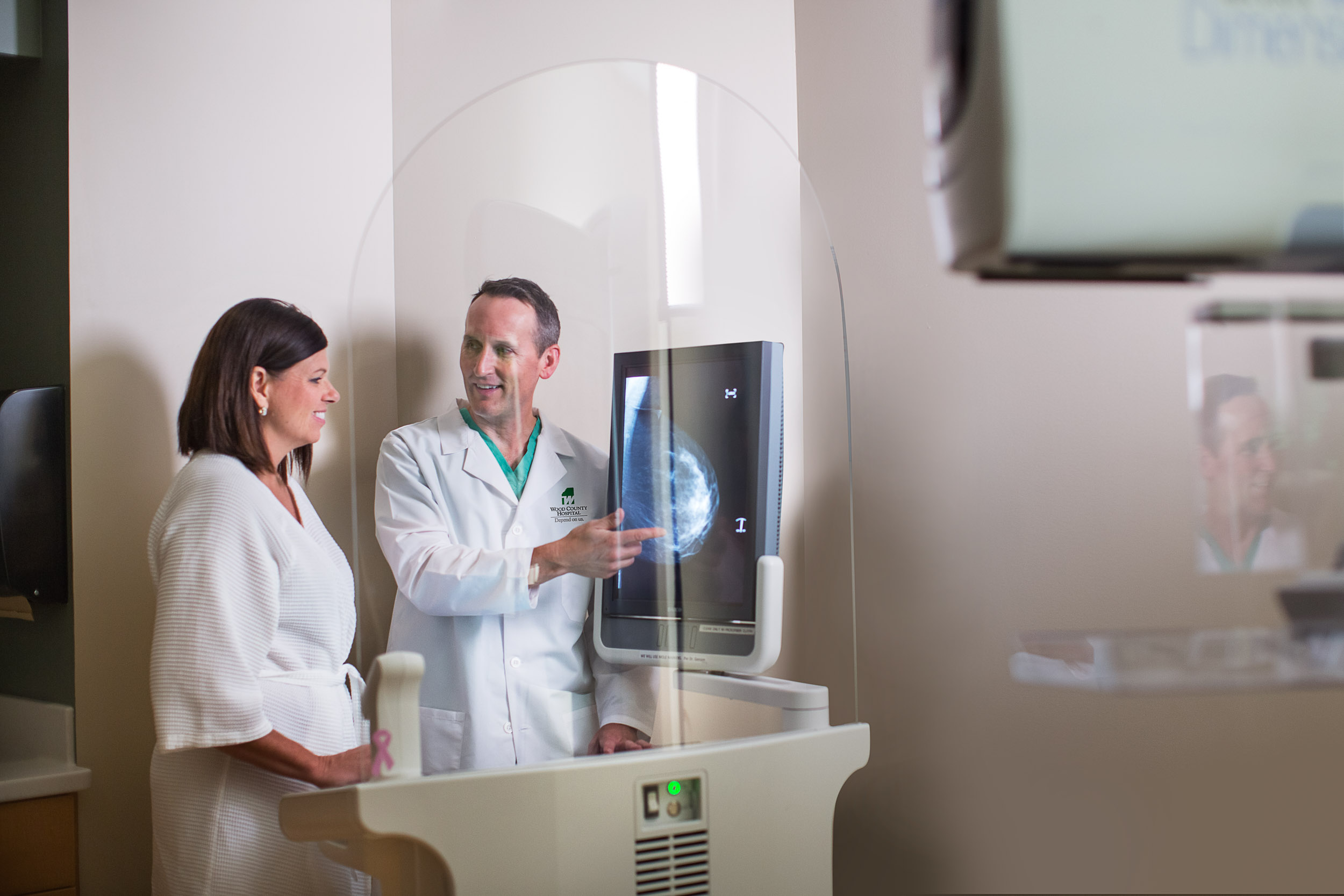 commercial photography photo of male doctor showing patient x-rays