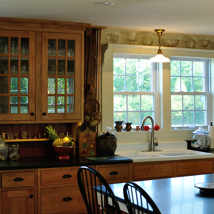 Apron sink, hutch top design, shelving above windows