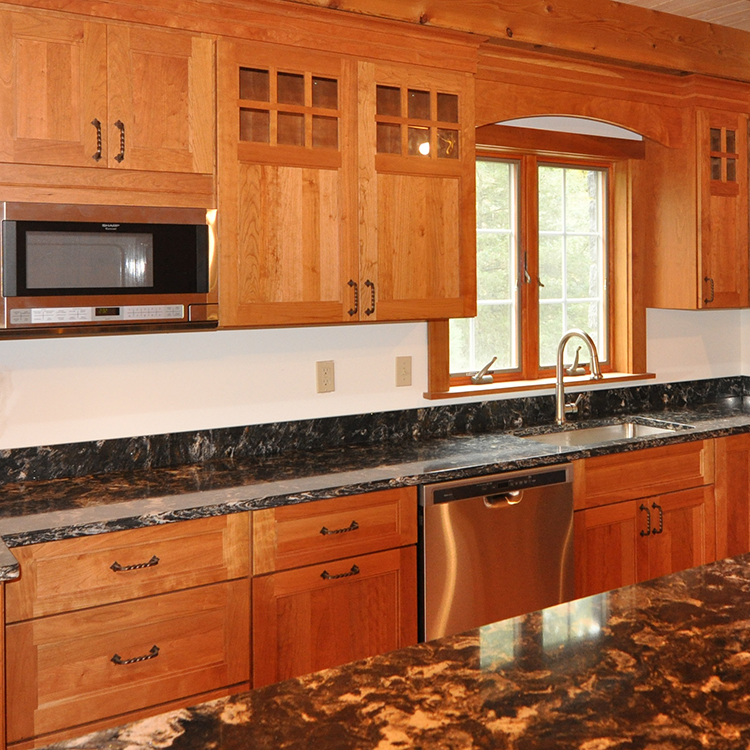 Cambria quartz top, built-in microwave, cherry flat panel doors & drawers, twisted wrought iron hardware