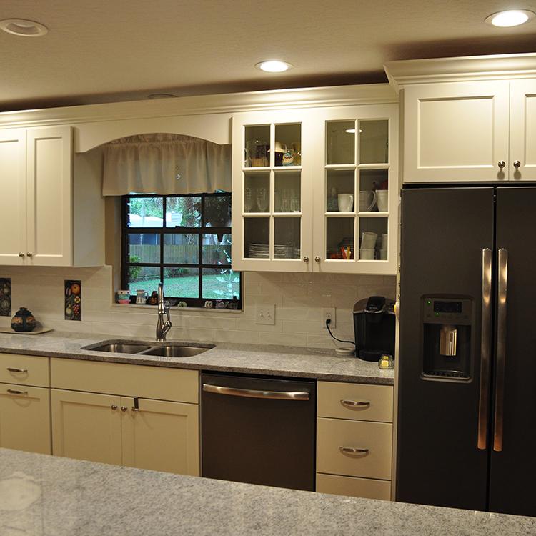 Graphite Appliances, Tile Backsplash, Light Gray Granite Tops, Glass Mullion Doors