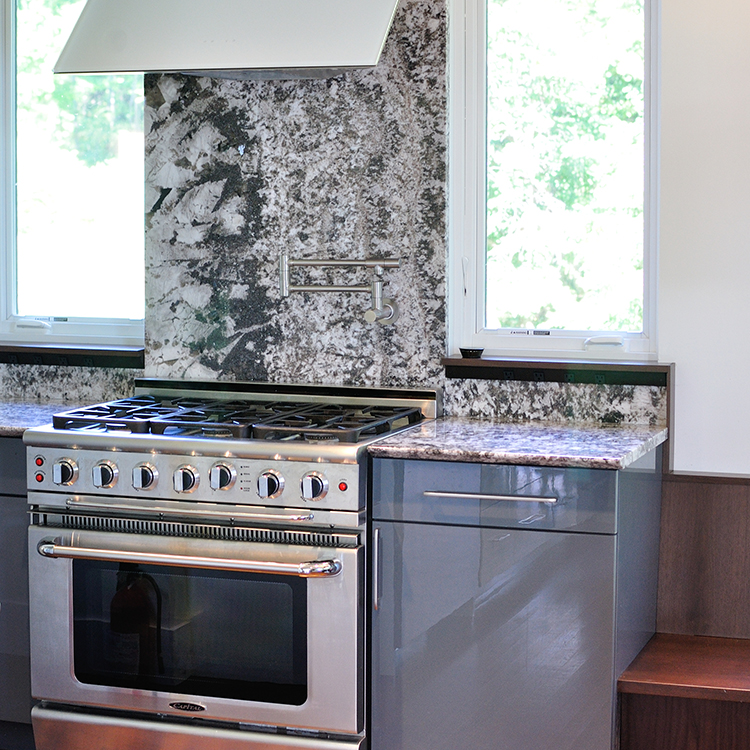Full Height Granite Backsplash, Gray Acrylic Faced Cabinets, Integrated Windows, Zephyr Hood