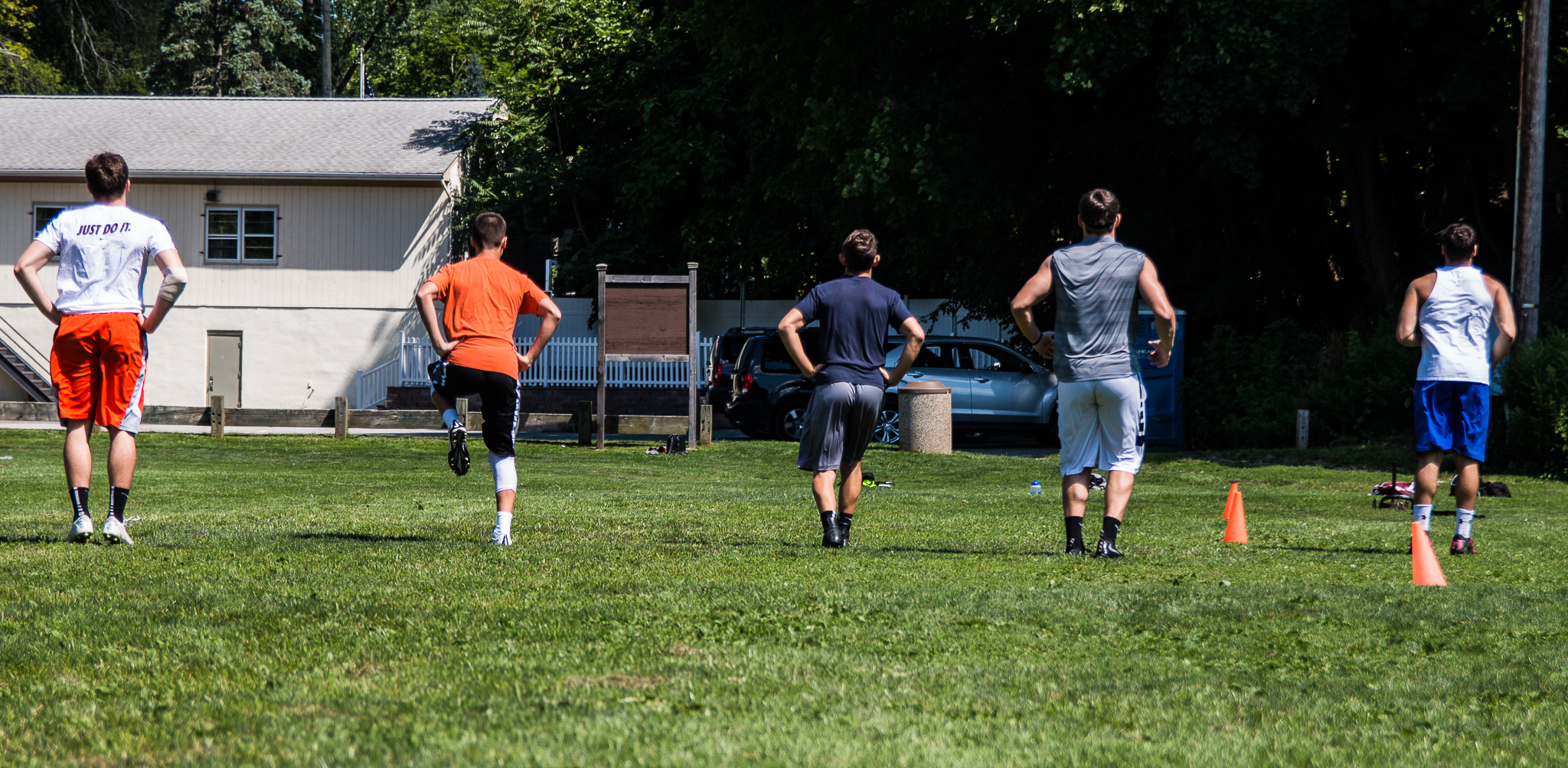 """""""In these photos you will see 4 athletes who are mid way through the summer using the sled (resistance) and 1 athlete who has been training since the spring using assistance. Even in a group setting individual needs are met."""" -Mike Basciano"""