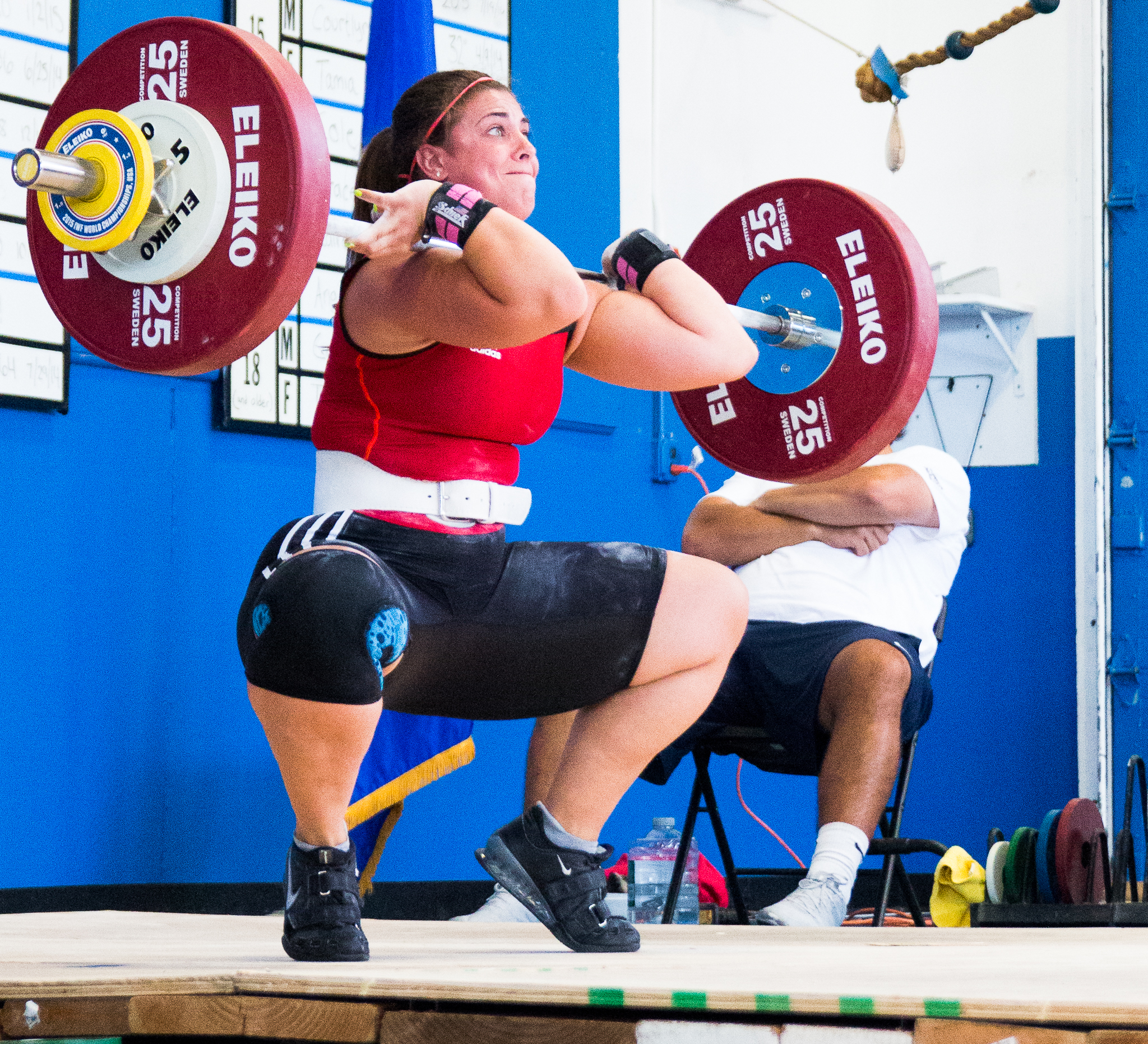 This weightlifter I had to highlight.  Your eyes aren't fooling you.   Yes, she is on her tippy toes .  She wanted to complete the clean portion of her lift so bad.  The entire room could feel it in their bones.