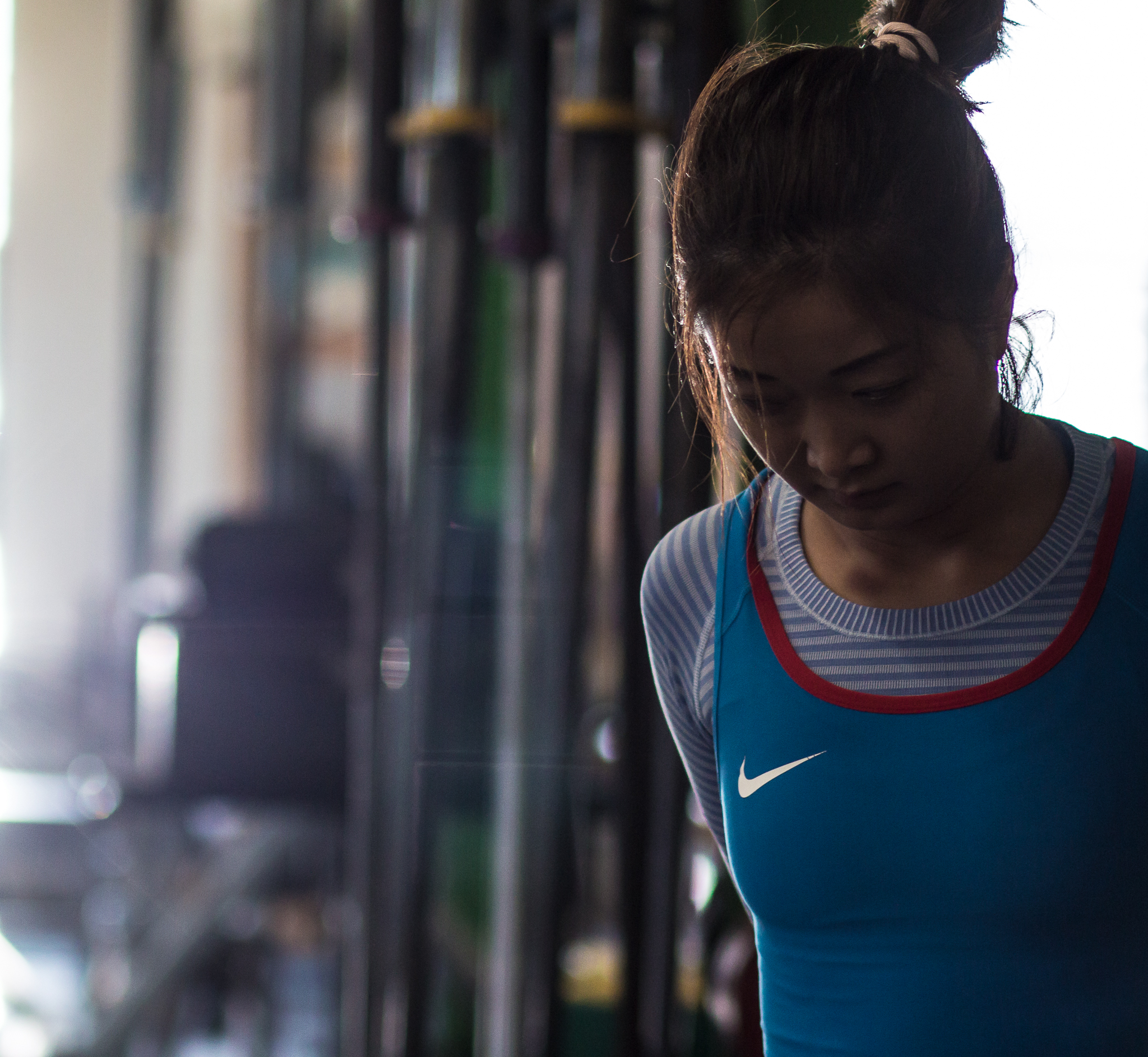 """""""Weightlifter on deck."""" Waiting for her turn to go up. Normally, the head down is the international sign of don't talk to me, I'm focusing on my lifts."""