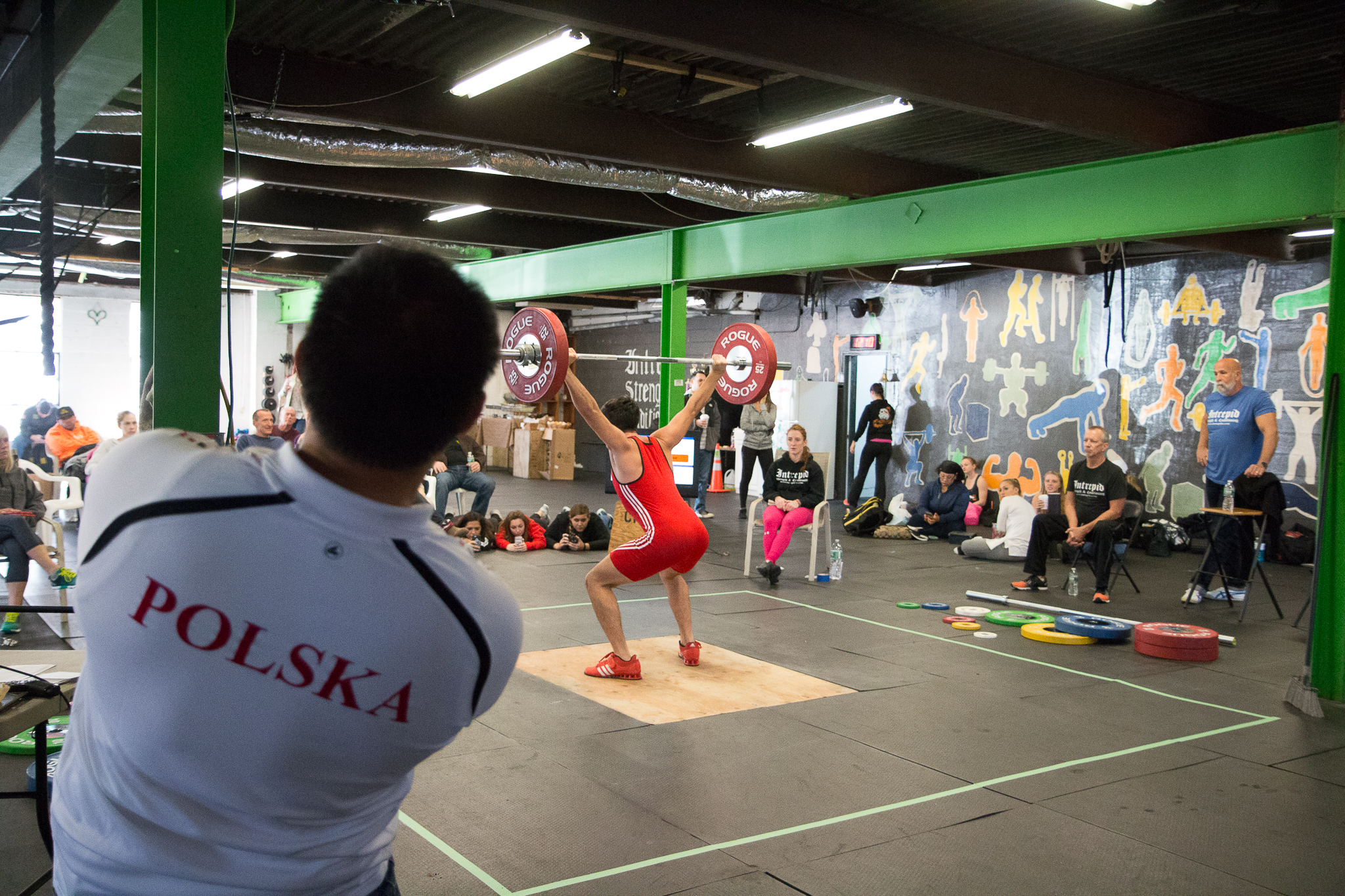 """""""The Coach Lean Back Posture"""" by coach Joel Quintong from   Sacred Heart University Weightlifting  . He is doing more than just looking at his lifter. He is checking his form and giving cues."""