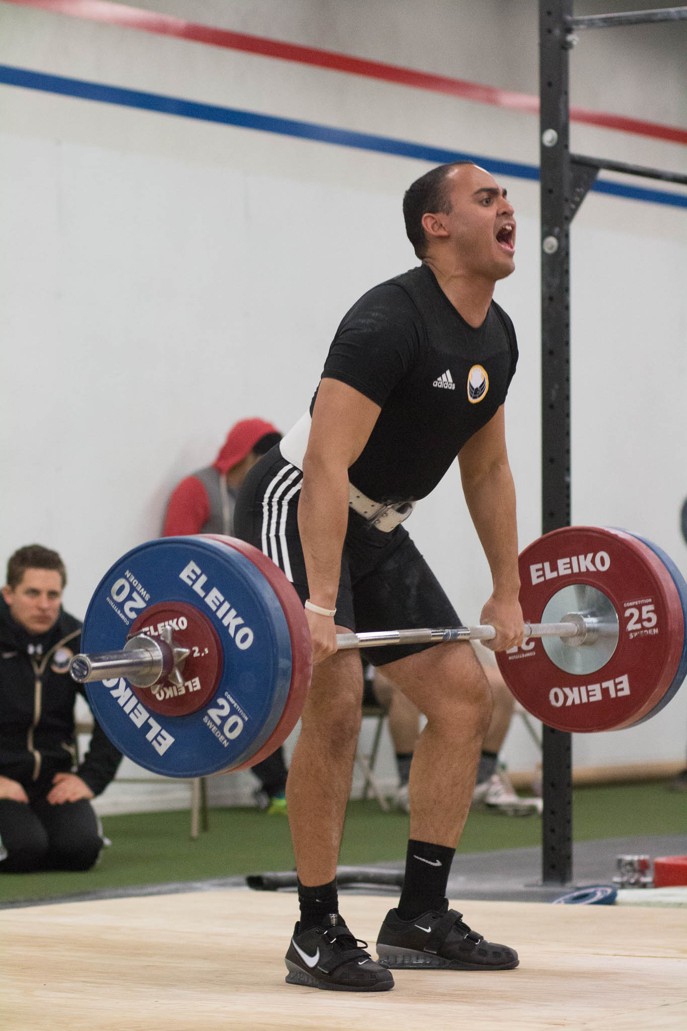 I'd like to highlight the coach in the background.  His face is just as intense as the lifter on the platform.