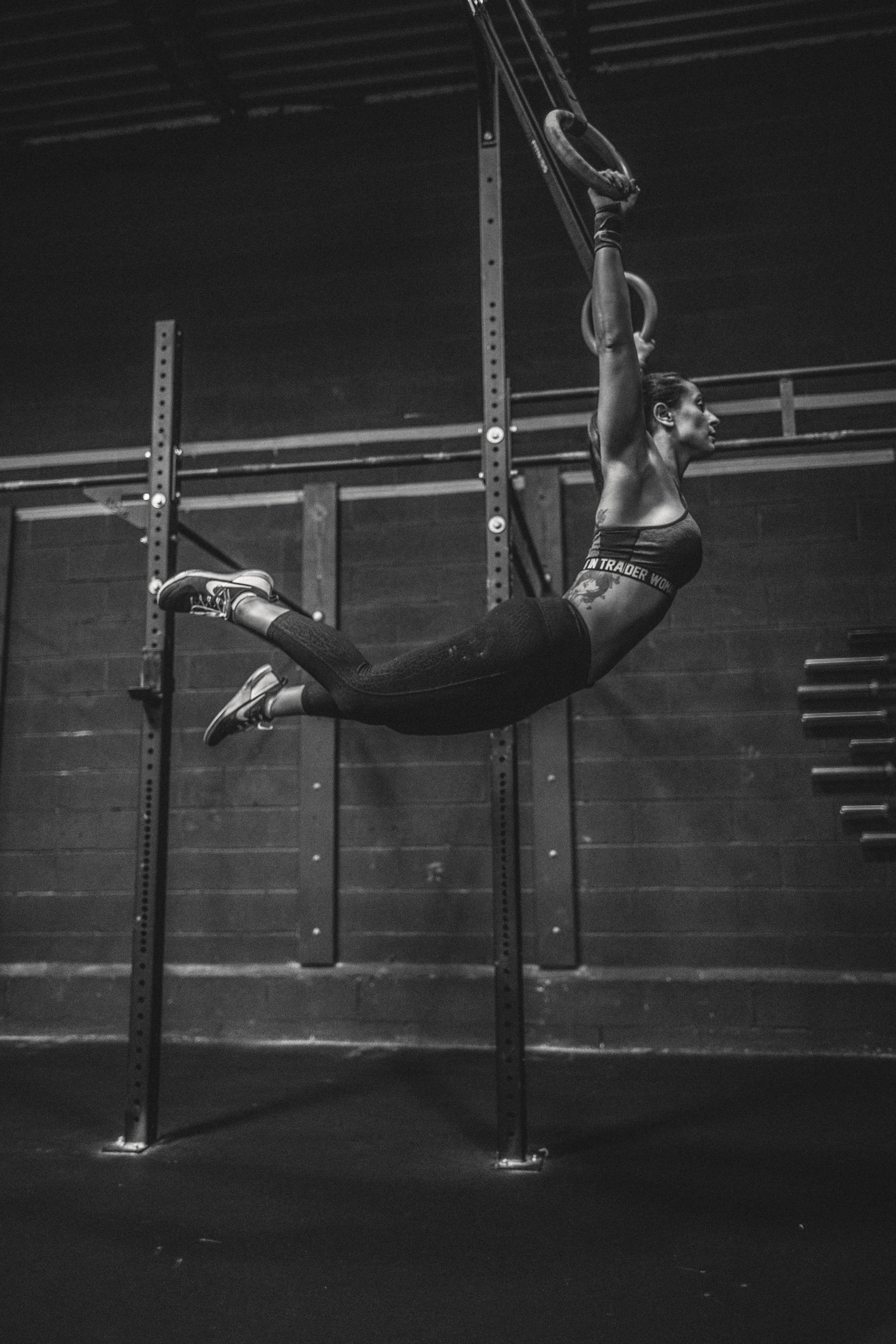 ring-muscle-up-blacl-white-female-crossfitter.jpg