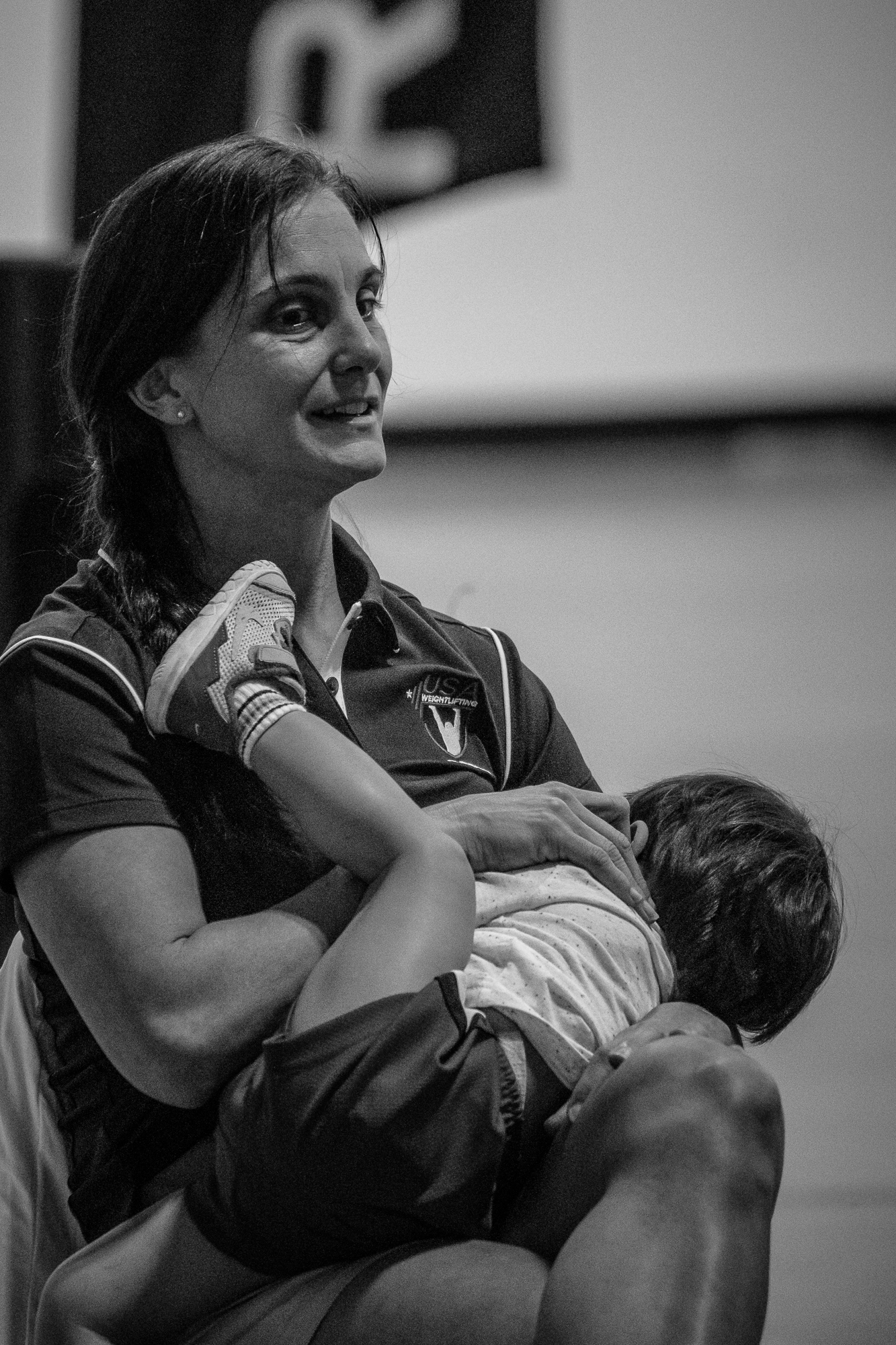 coach-baby-sleeping-weightlifting-youth-weightlifters-weightlifting-moms