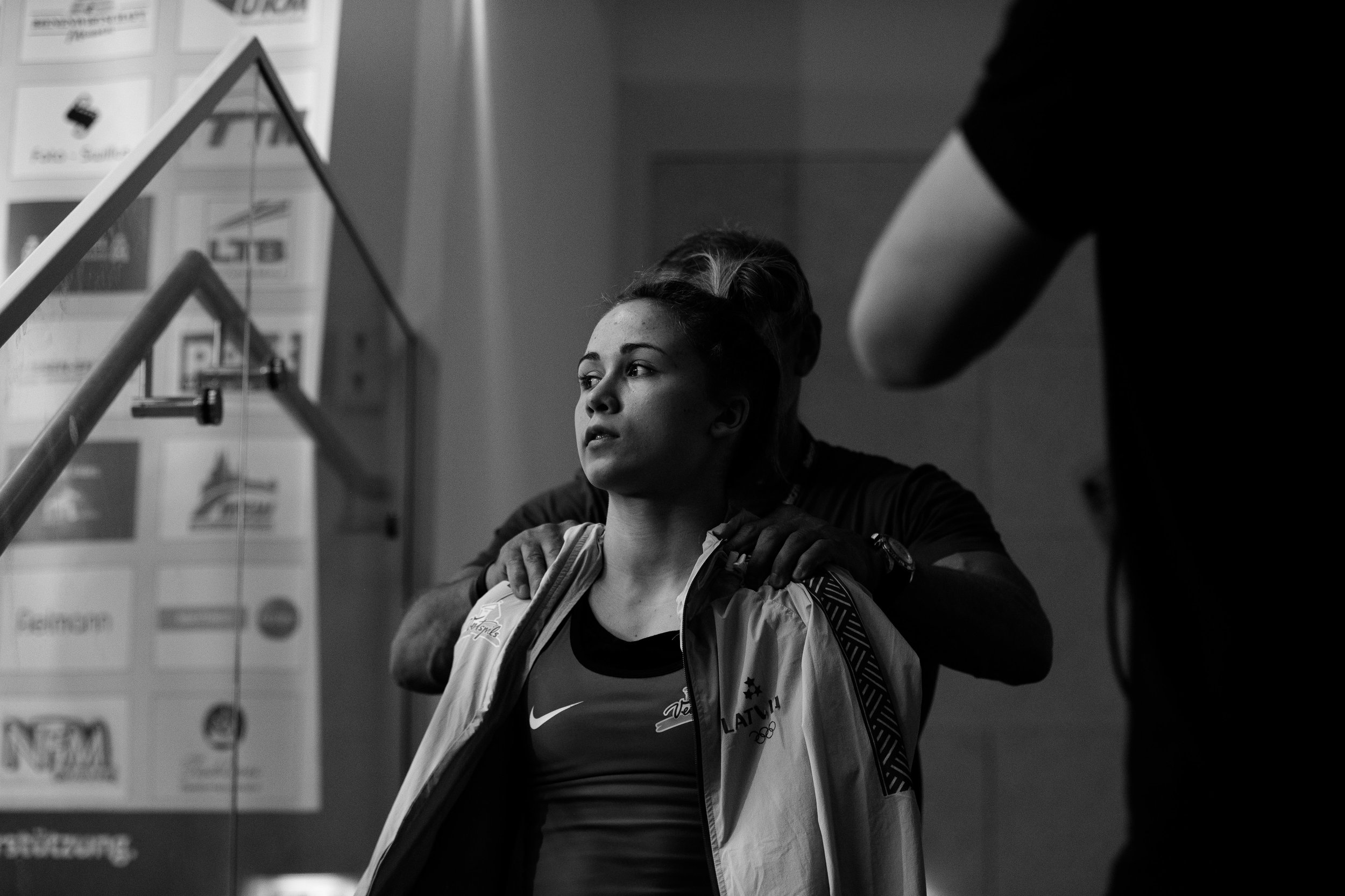 "Weightlifter:  Rebeka Koha    Every time time she went up to lift, her coach would repeat the word, ""Champion""  out loud."