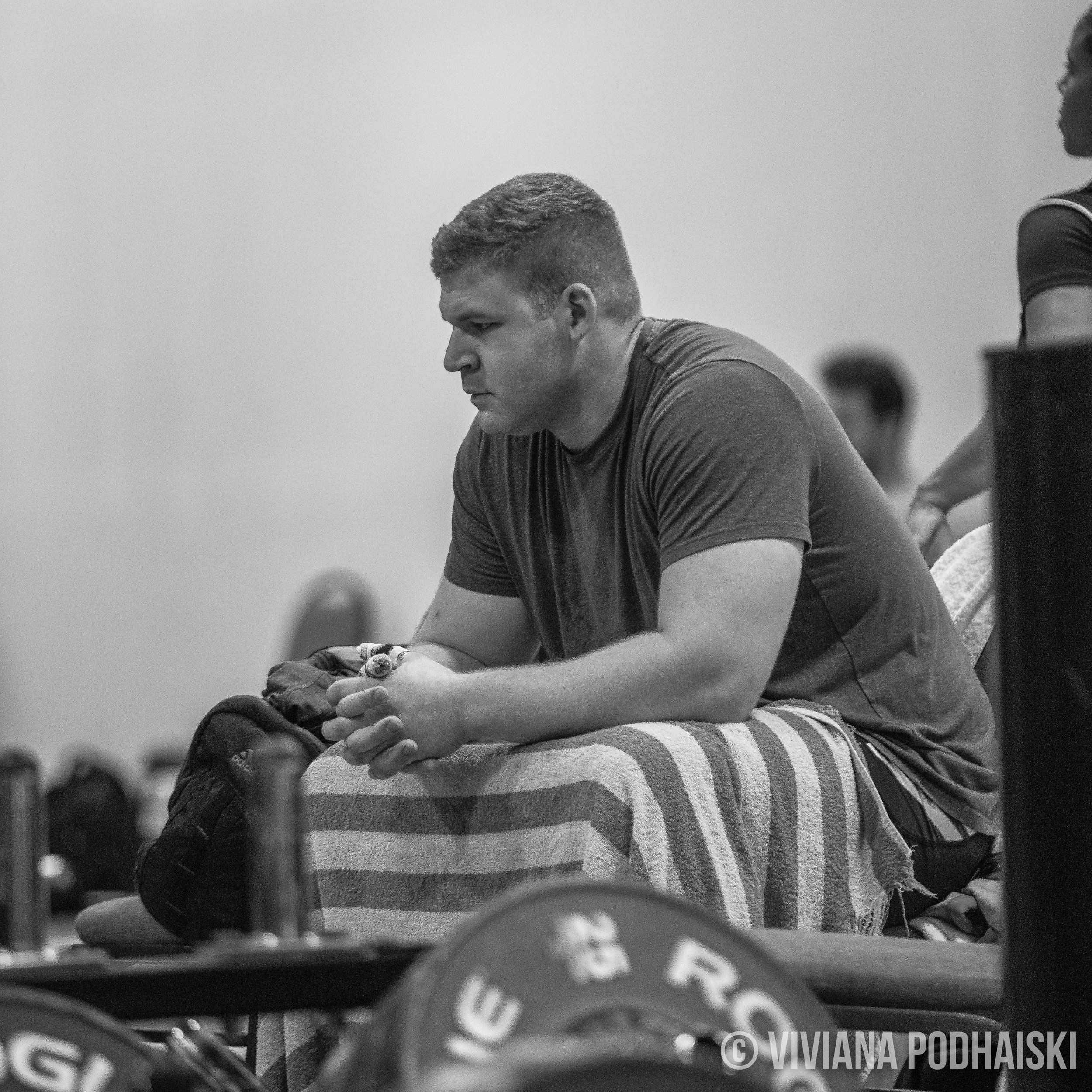 After closely photographing hundreds of weightlifters in the warm up area for the last 2 years, I can see when the brain starts to wander a bit.  The few frames prior to this shot, you can see a change in Witte's face.  Apprehension? Nerves?  Or it wasn't that deep and he was wondering whether or not he left the stove on? We've all been there.