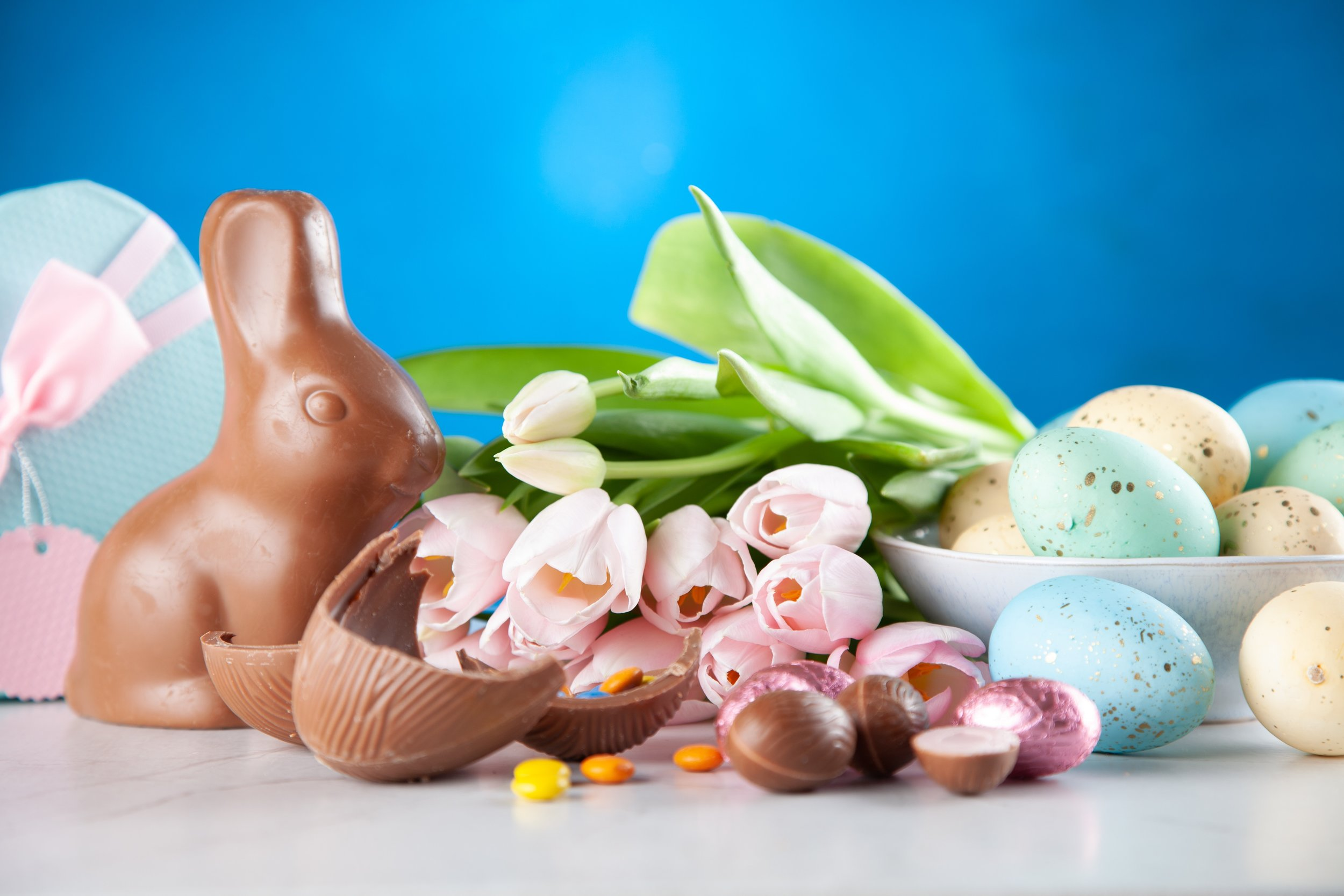 Easter eggs chocolate bunny and flowers.jpg
