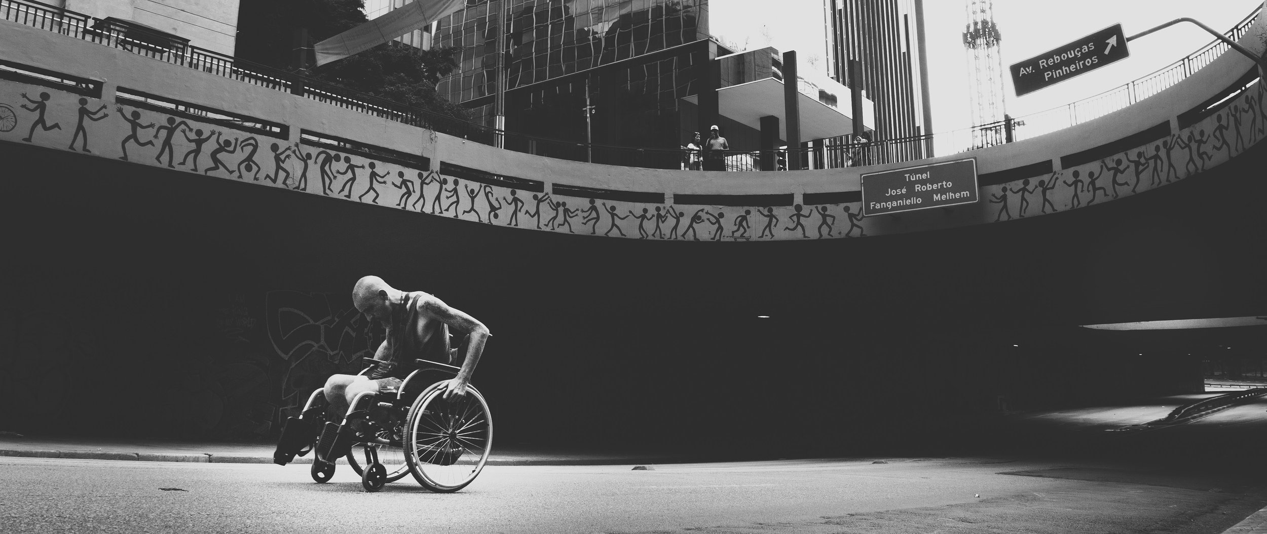 Disabled man wheelchair alone on street.jpg