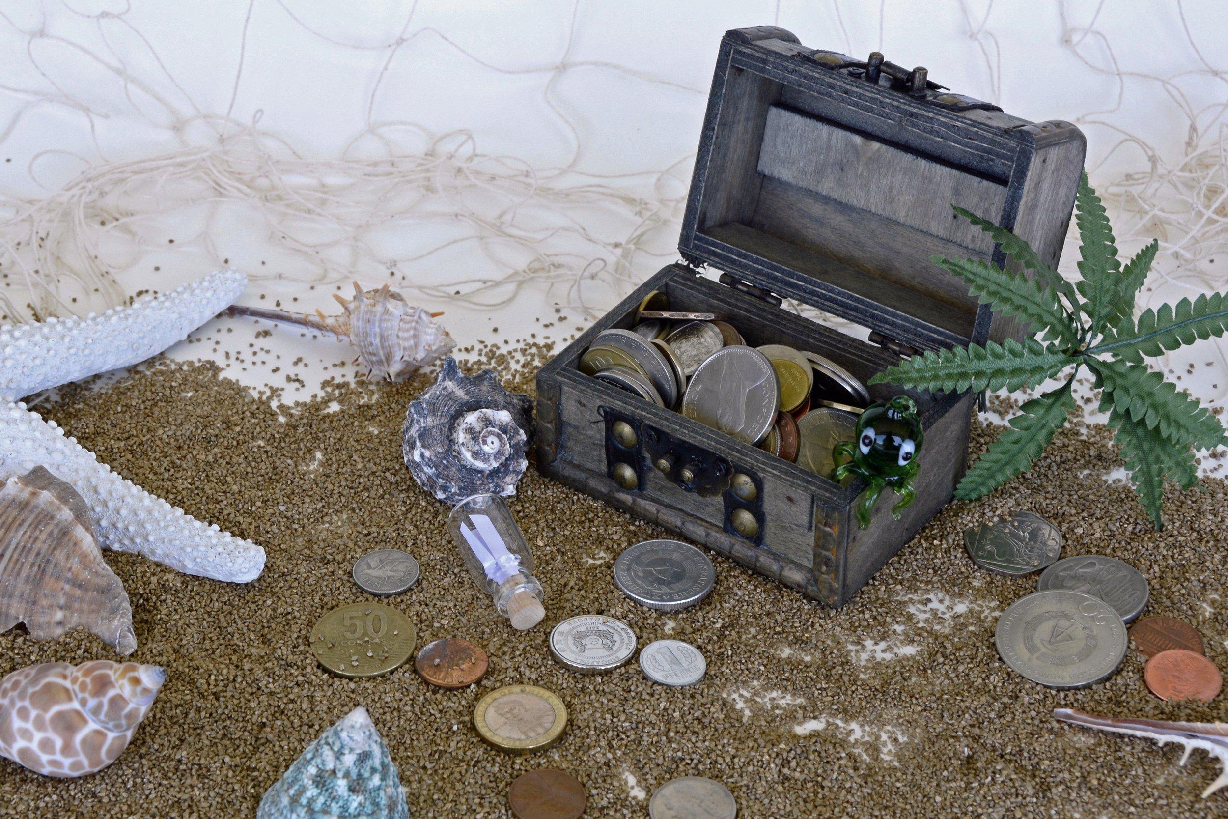 Treasure chest coins beach.jpg