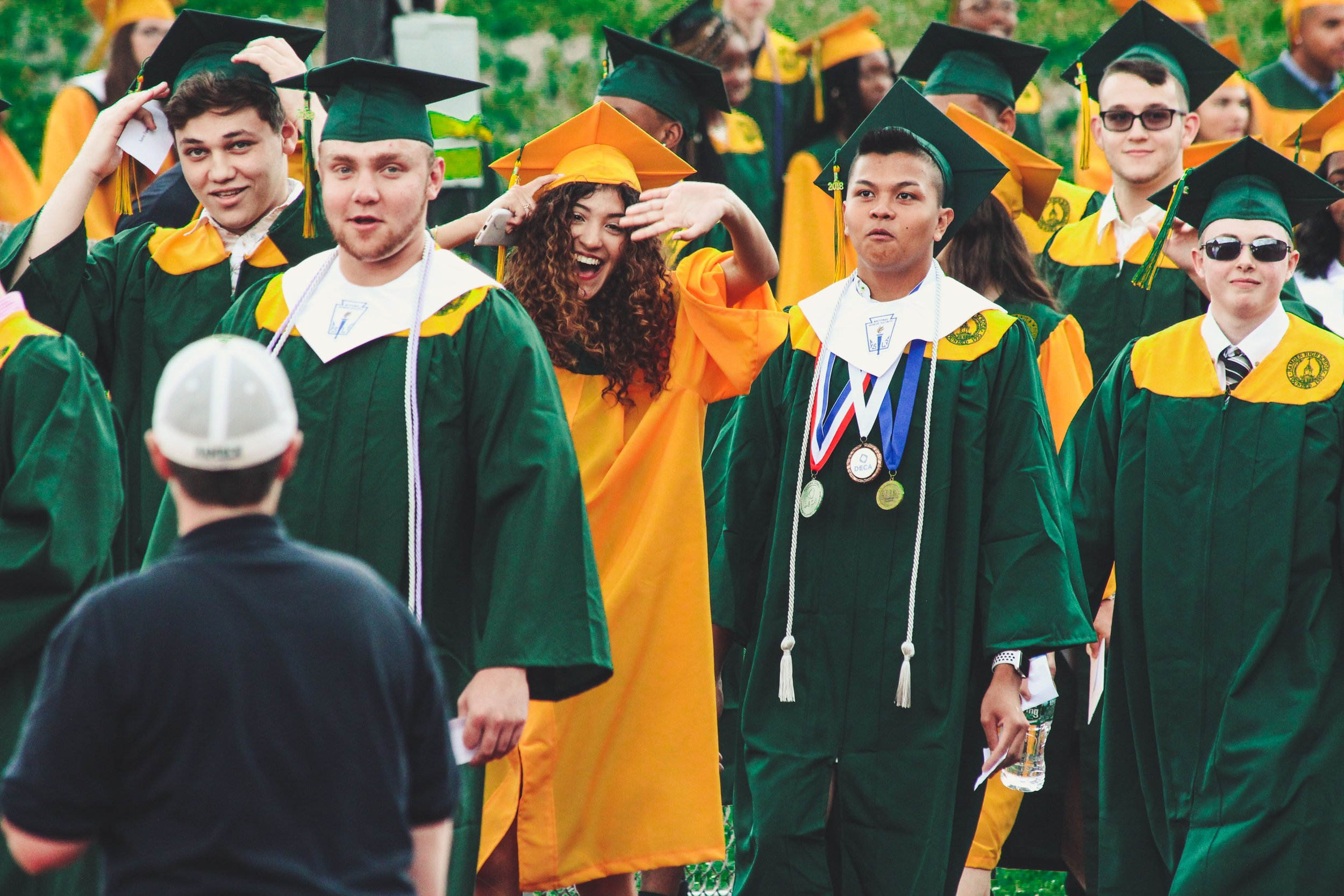 Graduation students walking in cap gown.jpg