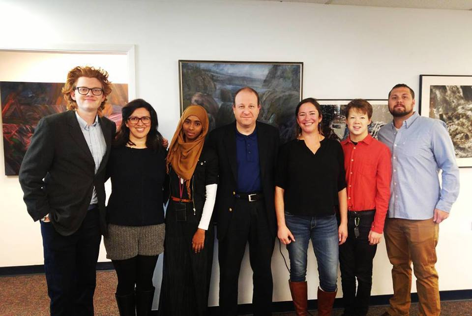 Stories Without Borders Team on set with Congressman Polis for Beyond the Wall II