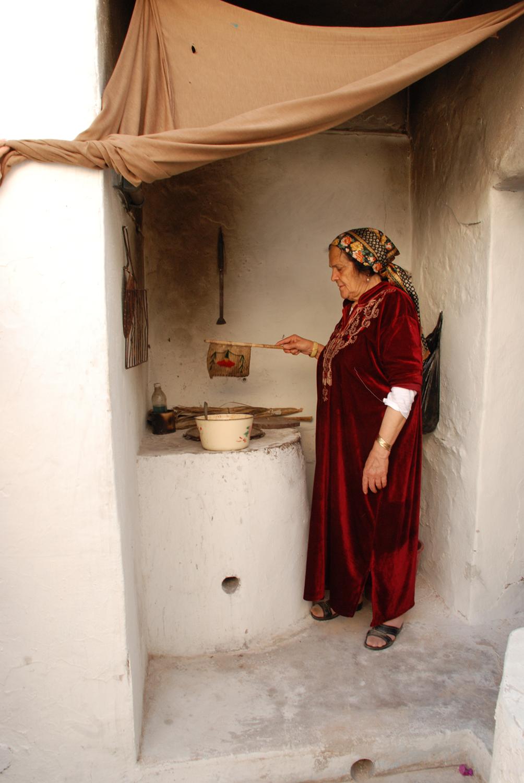 Fanning the Fire-  Hara Seghira, Djerba, Tunisia