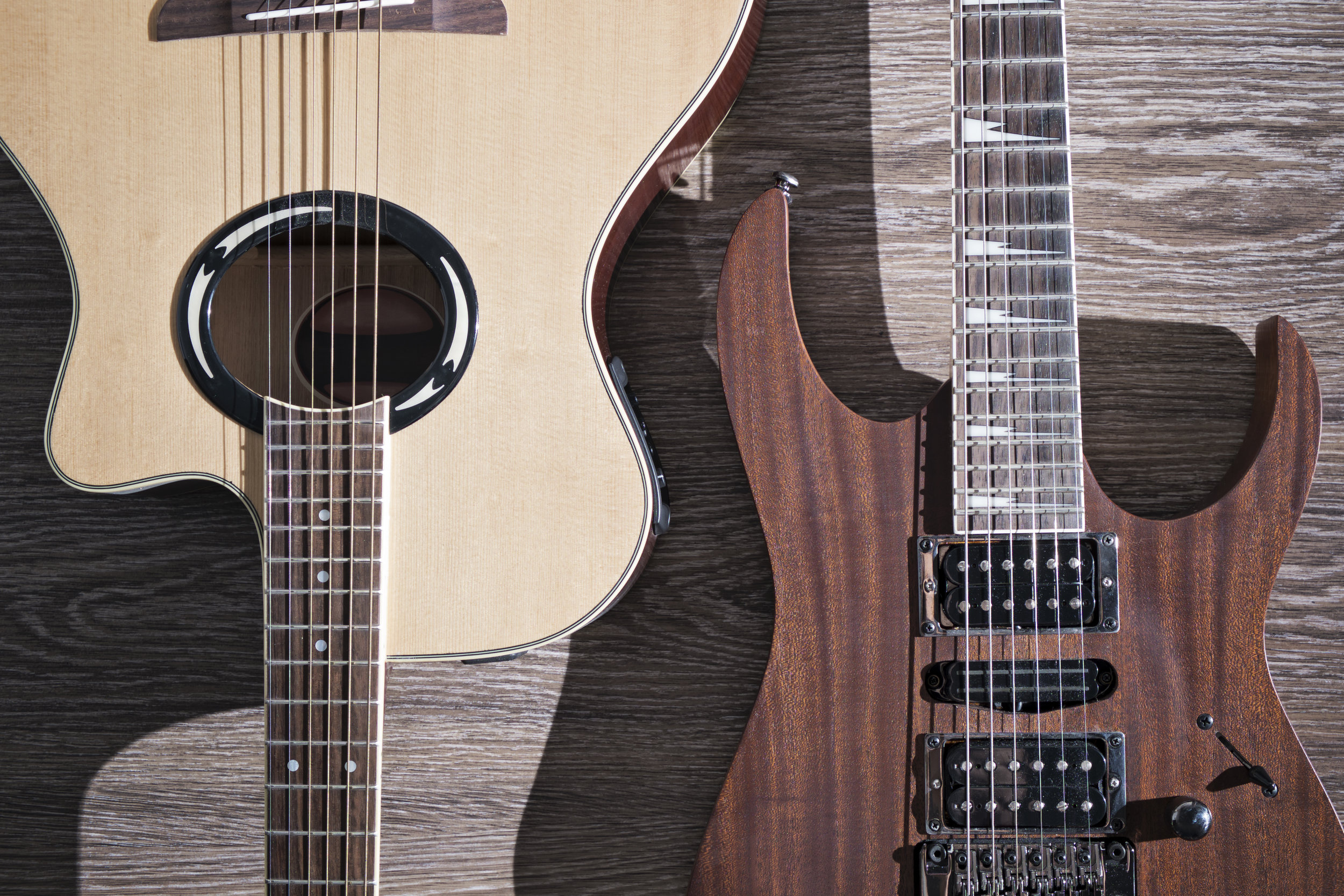 how to choose between an acoustic or electric guitar