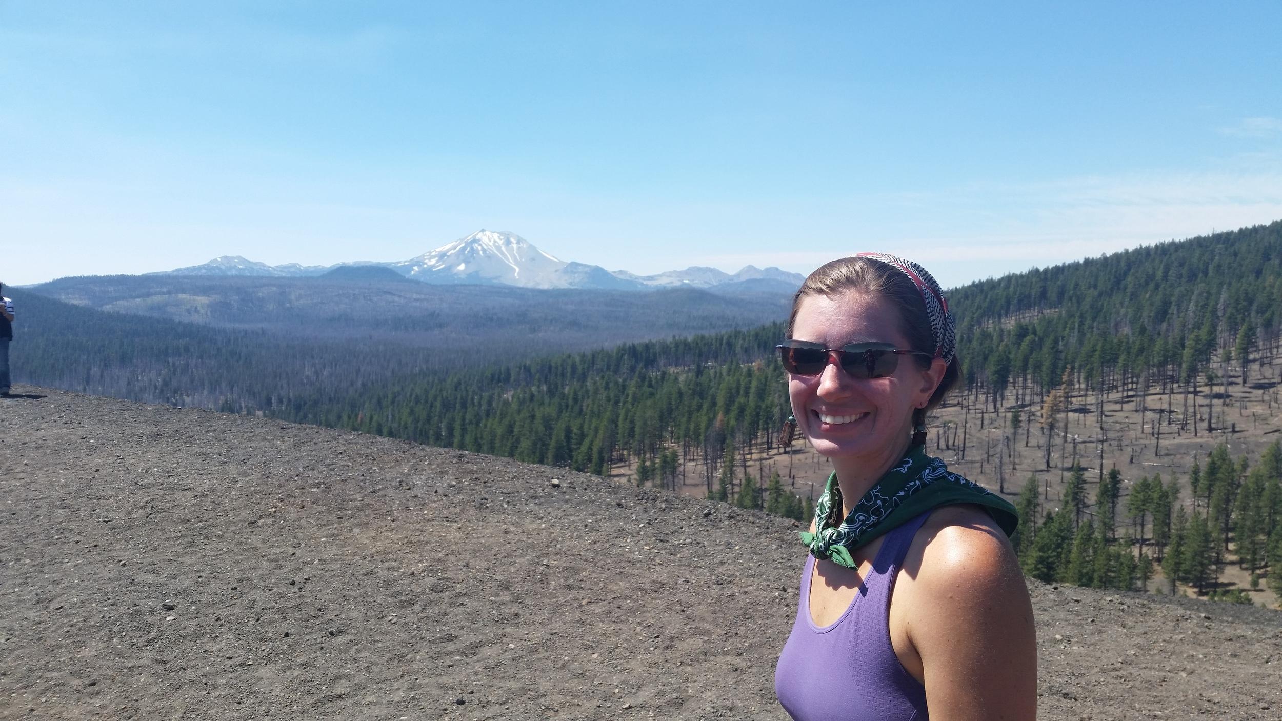 Alli at the top of Cinder Cone, enjoying views of Lassen Peak.