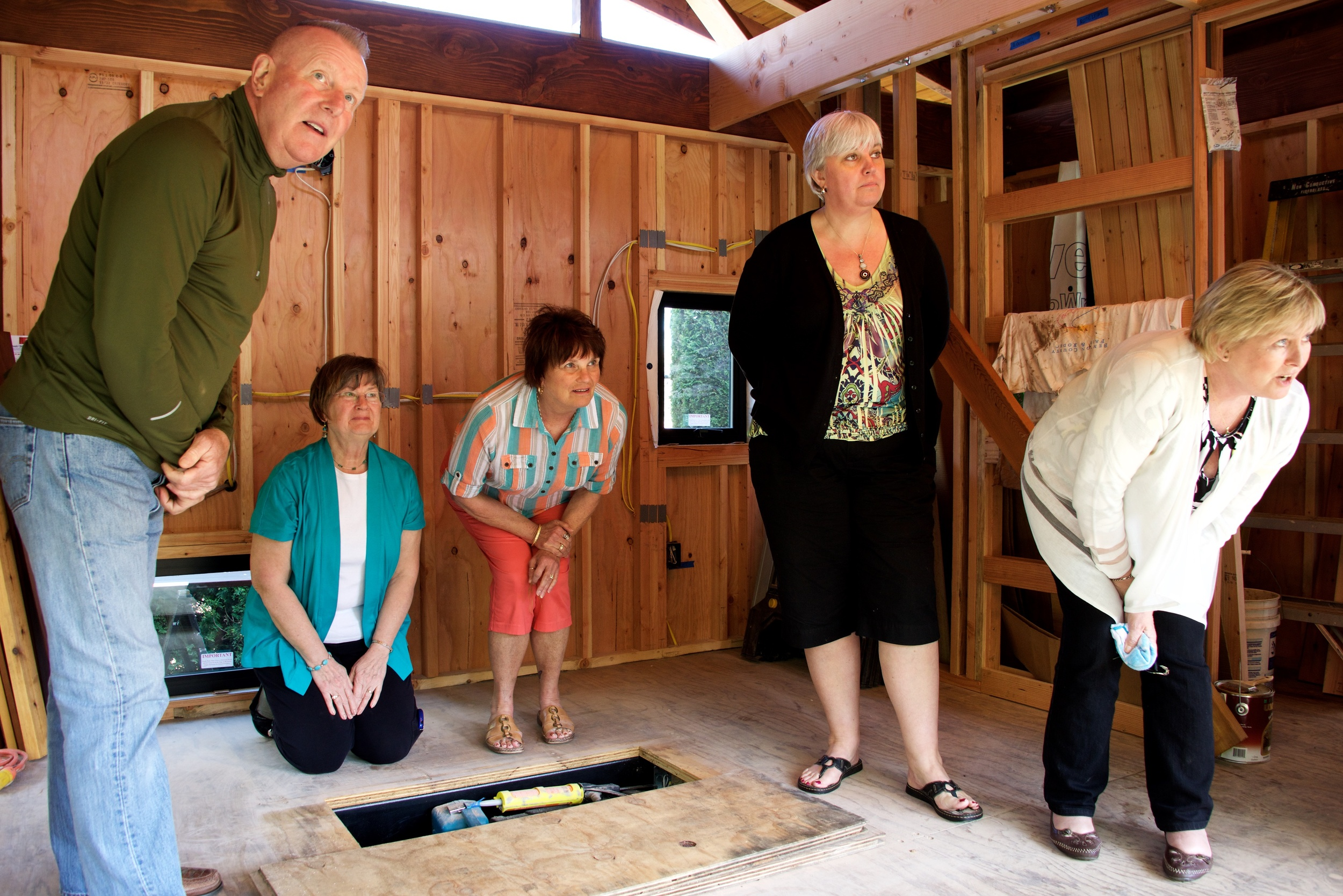 Bill's sister, Sorena Brusseau (center), and her friends visit the tea house early in construction.