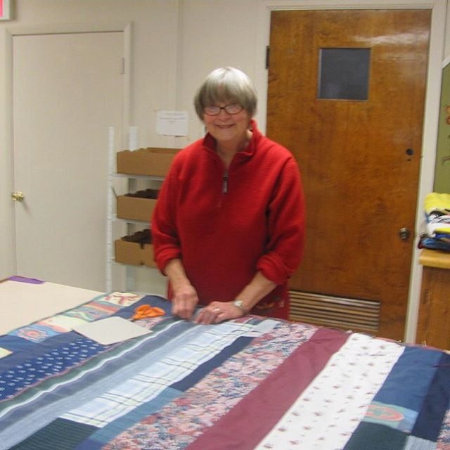 Trinity Quilters - projects include quilts for Island residents who are ill or in special need, a gift for each graduating senior, and quilts for overseas relief. Here Barb is working on tying her quilt.