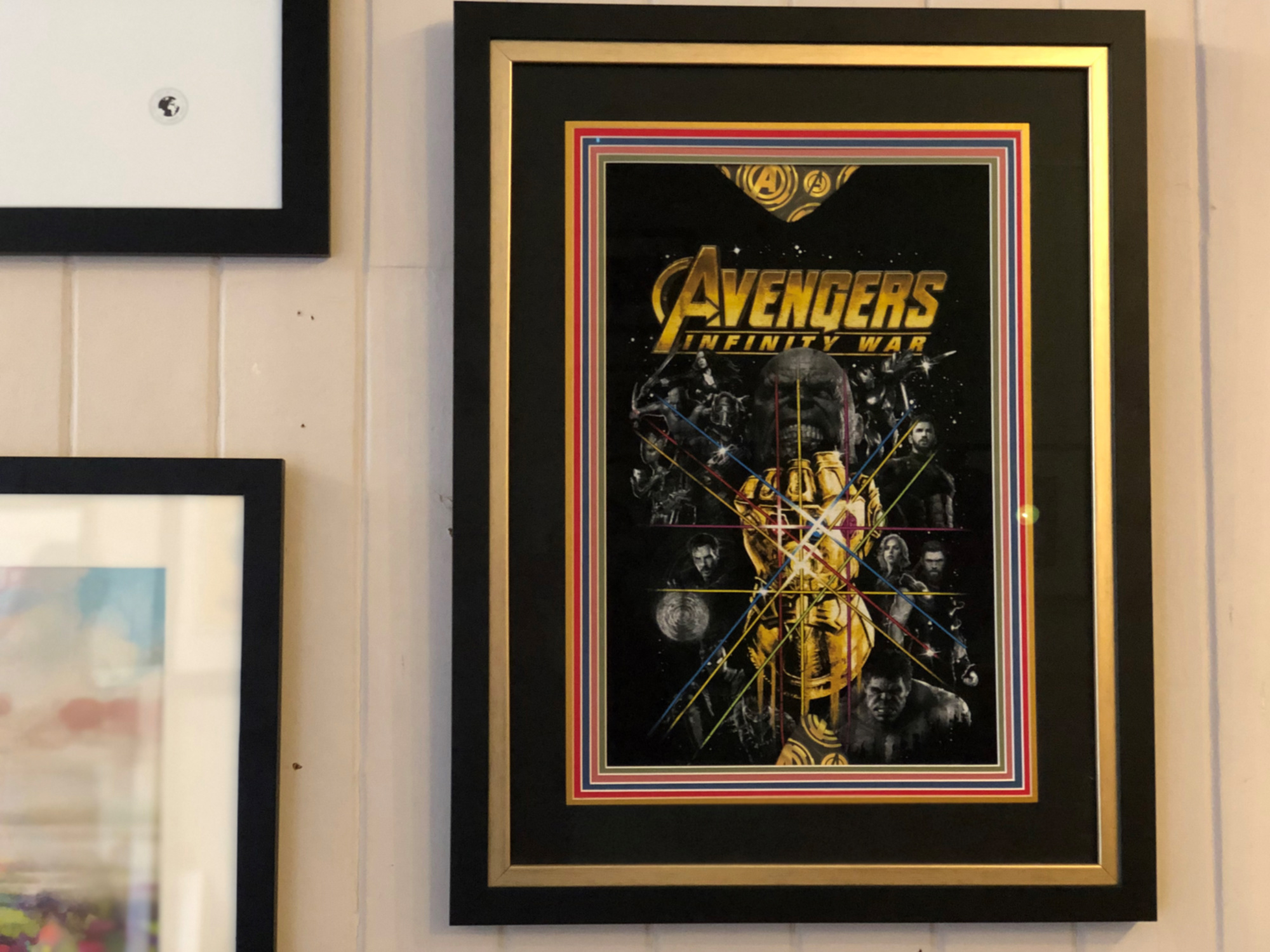 This Avengers poster is one of my all-time favourite examples of professional framing. It blew my mind when I saw this incredible piece - a work of art in itself. The team at Mimi V's used 6 mounts - yes 6!! - each a different colour and each with a beveled white edge, adding depth to the picture. It was then double-framed to add another dimension. I love the way the gold stands out and links to the gold in the poster. What a stunning piece!