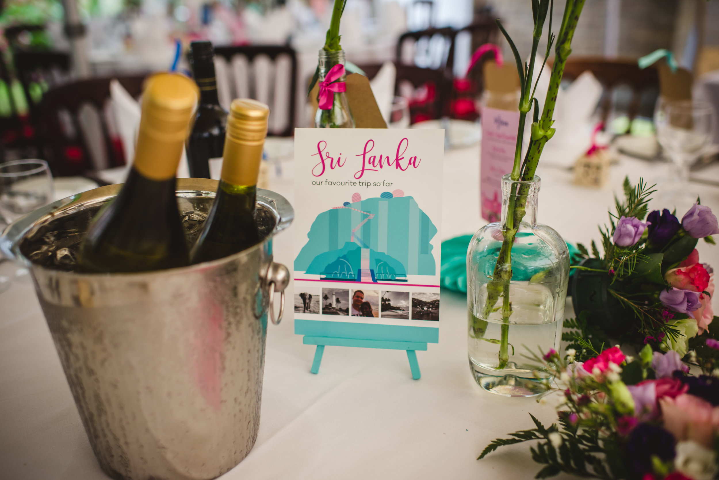 Travel-themed wedding table name by South Island Art