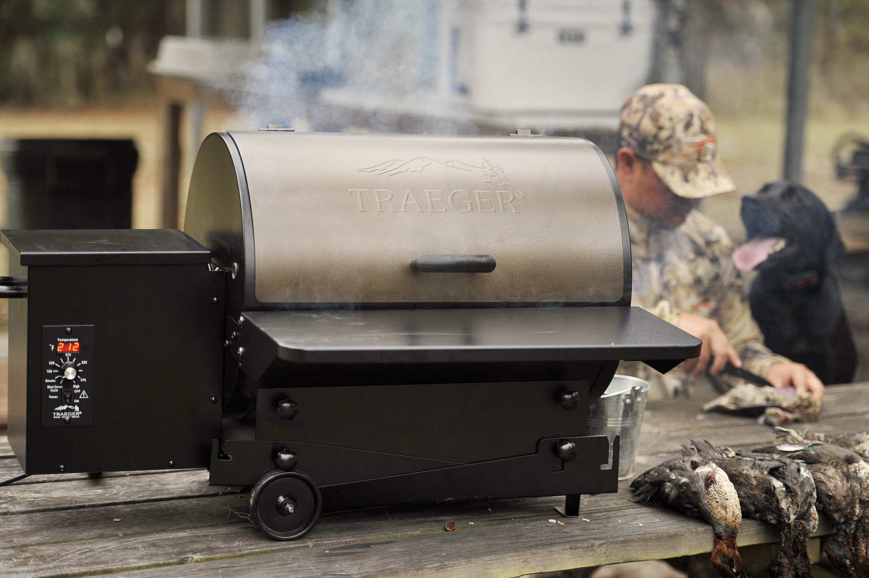 """The tailgater is the perfect grill for our hunting trips. The collapsable legs fold up under to sit on a table or fold out to stand on its own."""
