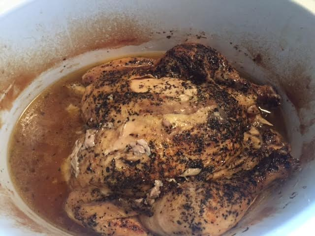 This is what my chicken looked like today after cooking for 8 hours. (I already took some of the broth out before I took this picture but the crockpot is usually filled halfway with broth!)
