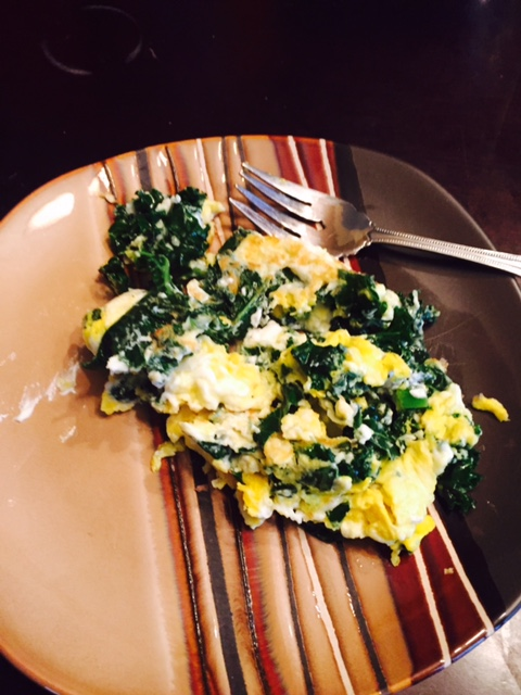 Breakfast! 2 Cage Free Organic eggs,  1 cup kale and 1 TBS of Goat Cheese. Cooked in Olive Oil.