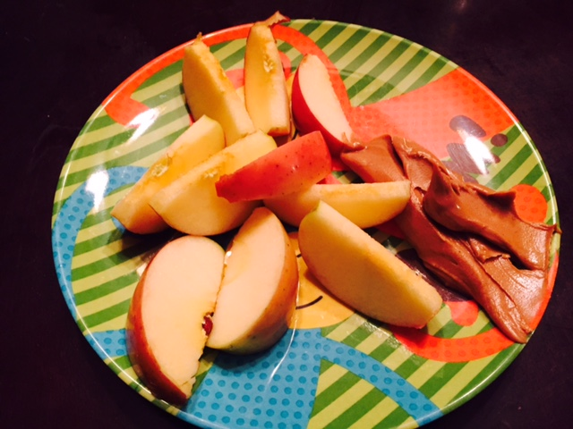 1 apple and 1/4 cup of natural peanut butter.