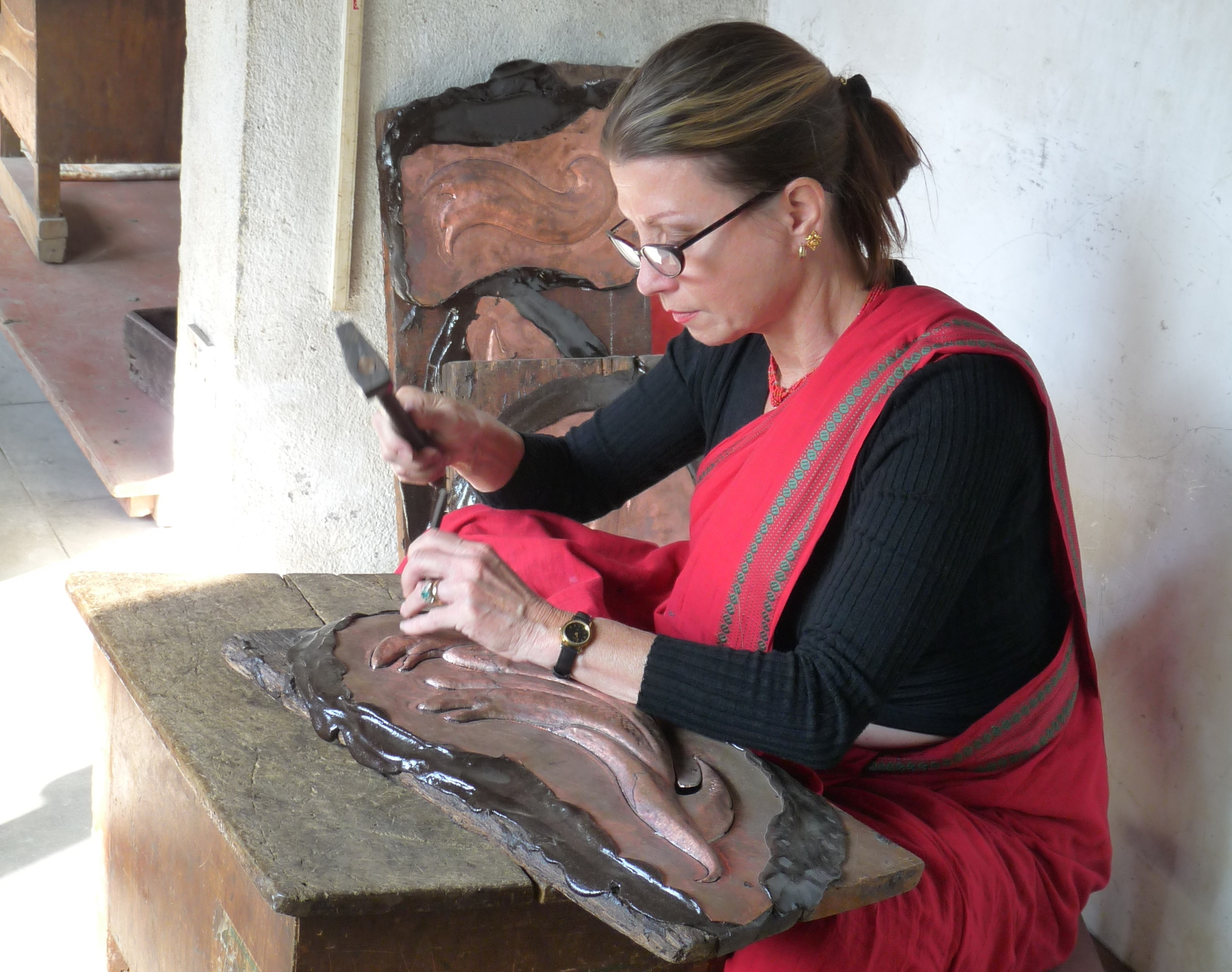 """Drdak working on repoussé elements of """"The Flying Nagas"""" in the atelier of Rabindra Shakya, Patan, 2012."""