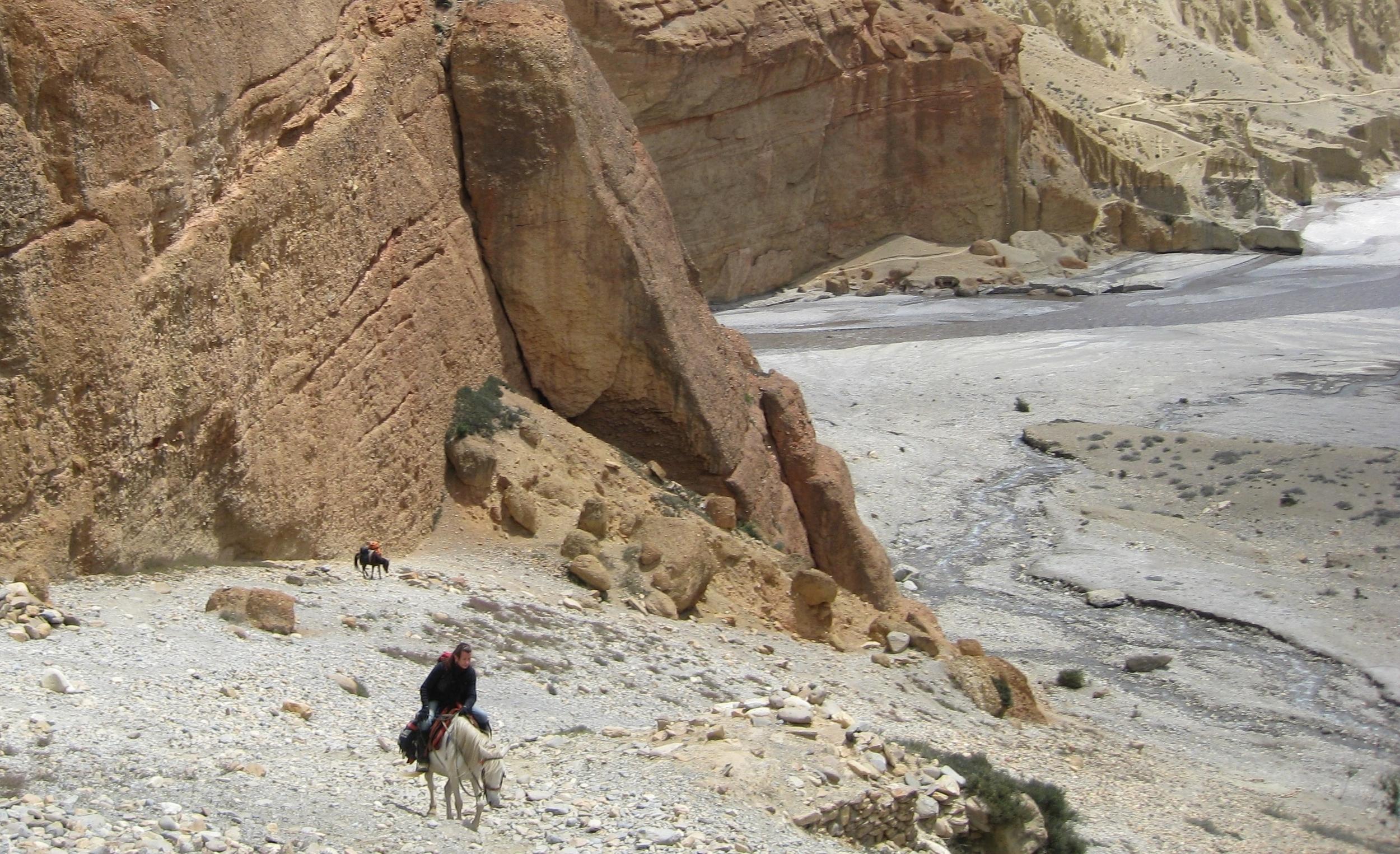 Drdak on Dolma ascending the path to Chele village near the Kali Gandaki's Mustang Gate, Upper Mustang 2008.