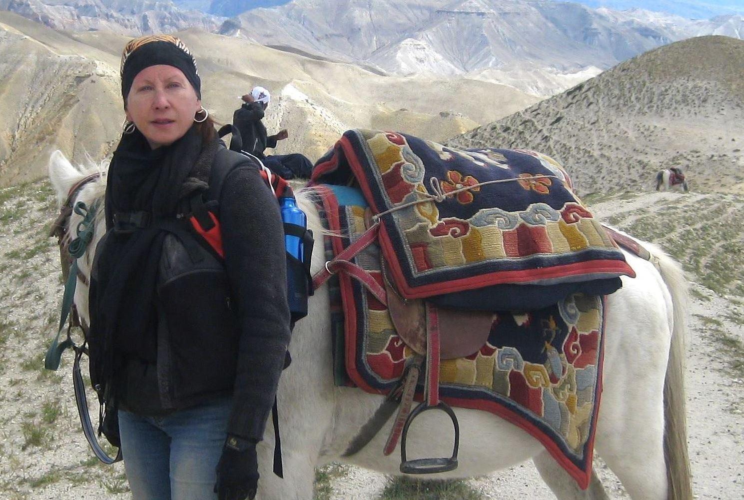 Maureen Drdak with her mare Dolma in Choser near the Tibetan border, Upper Mustang, Nepal, 2008.