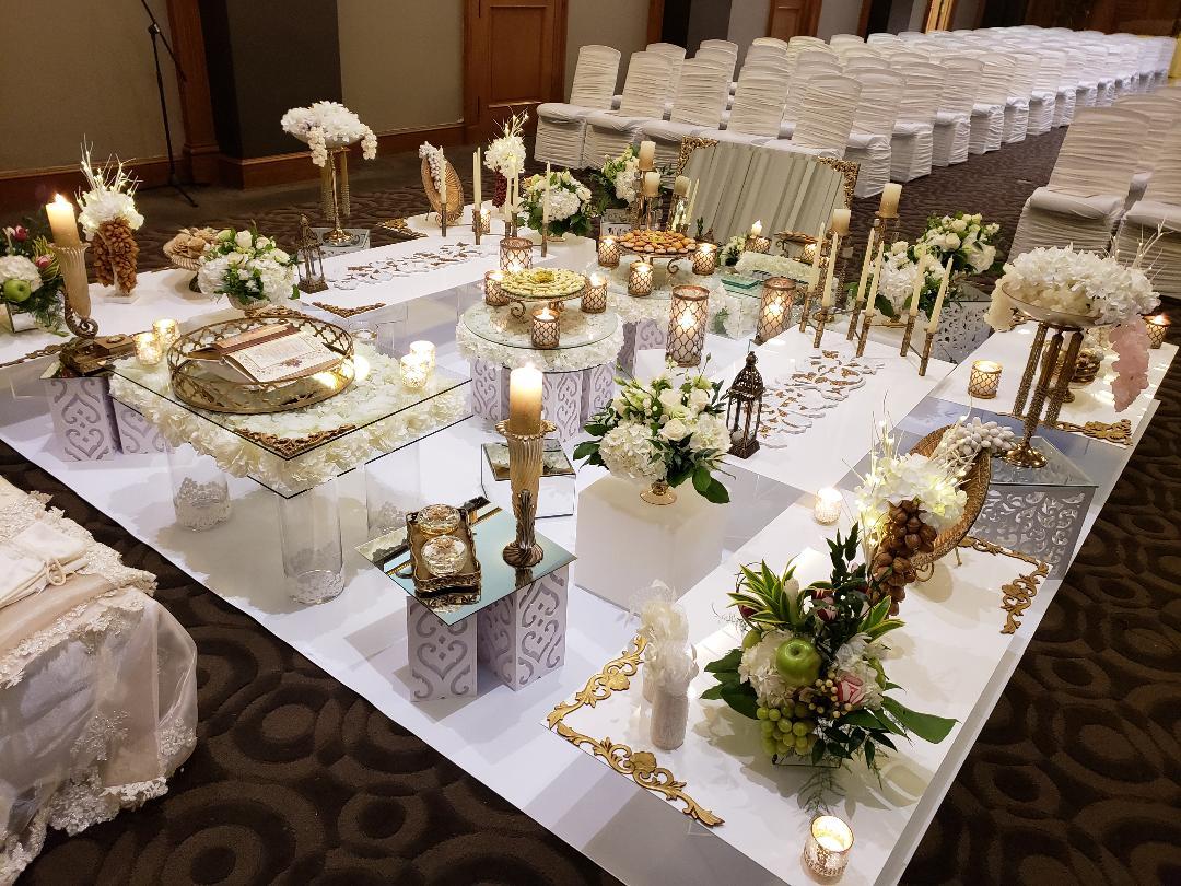 Antique Gold sofreh set up on white vinyl platform. One King West Hotel Toronto