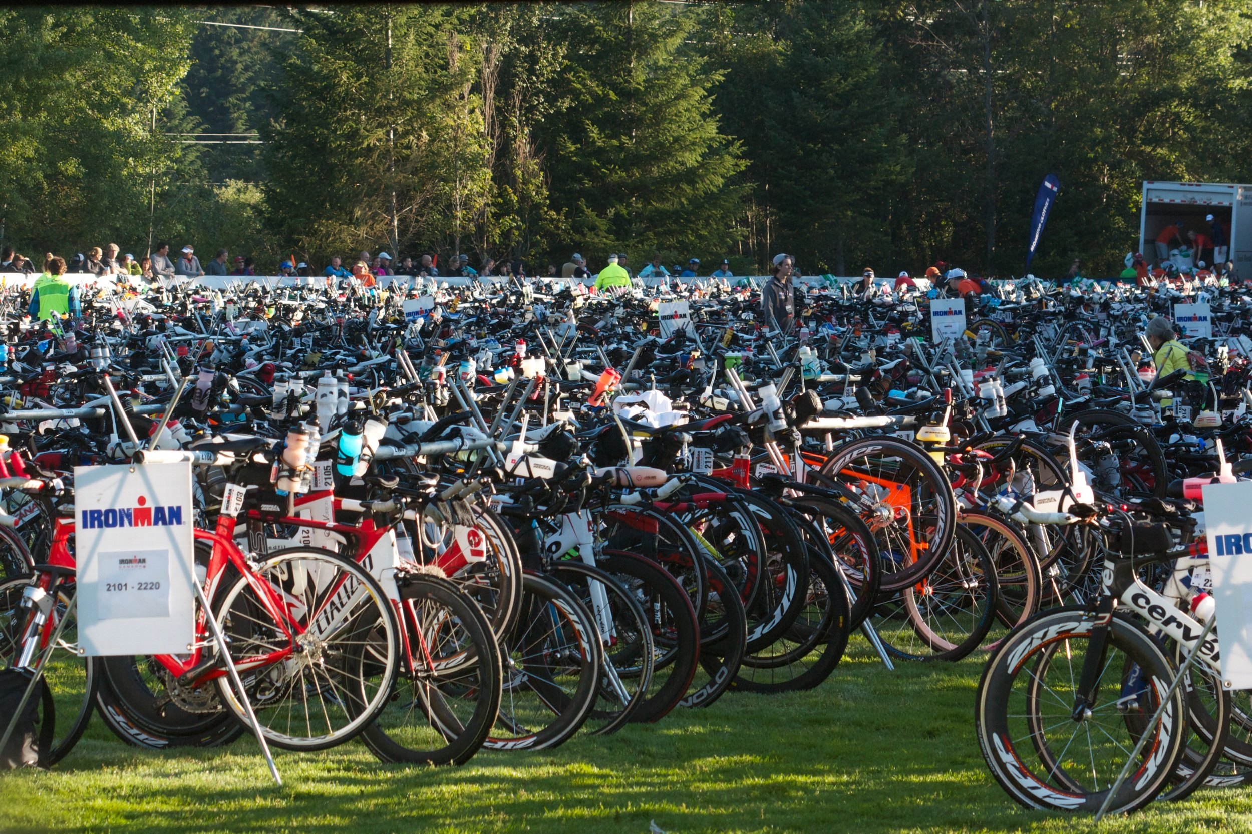 """The definition of Food + Gear for the athletes. This is """"T1"""" or the area where athletes transition from swim to bike. Those bikes are locked and loaded with all the food + gear the athletes will need for 180kms on the bike, the longest leg of an Ironman triathlon."""