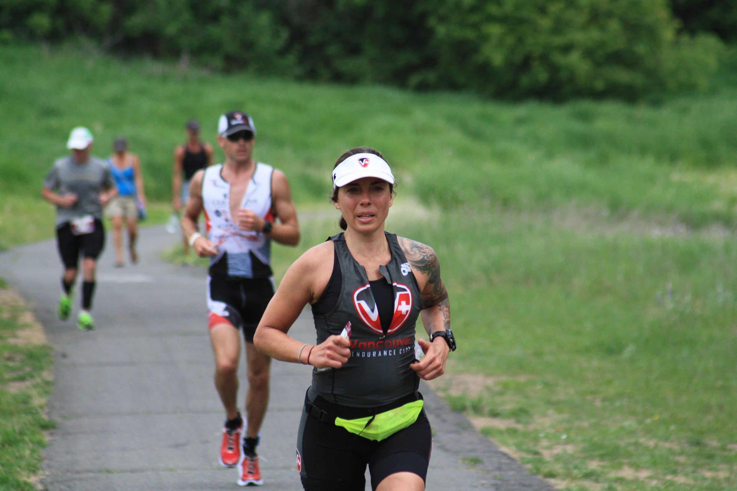 A quiet spot on the run course of a half-Ironman in Spokane, Washington. It's great to show up in these spots because you get to lift the athletes where they otherwise wouldn't get a boost. That's my friend Juliet in the picture, focused and laying it down on the run.