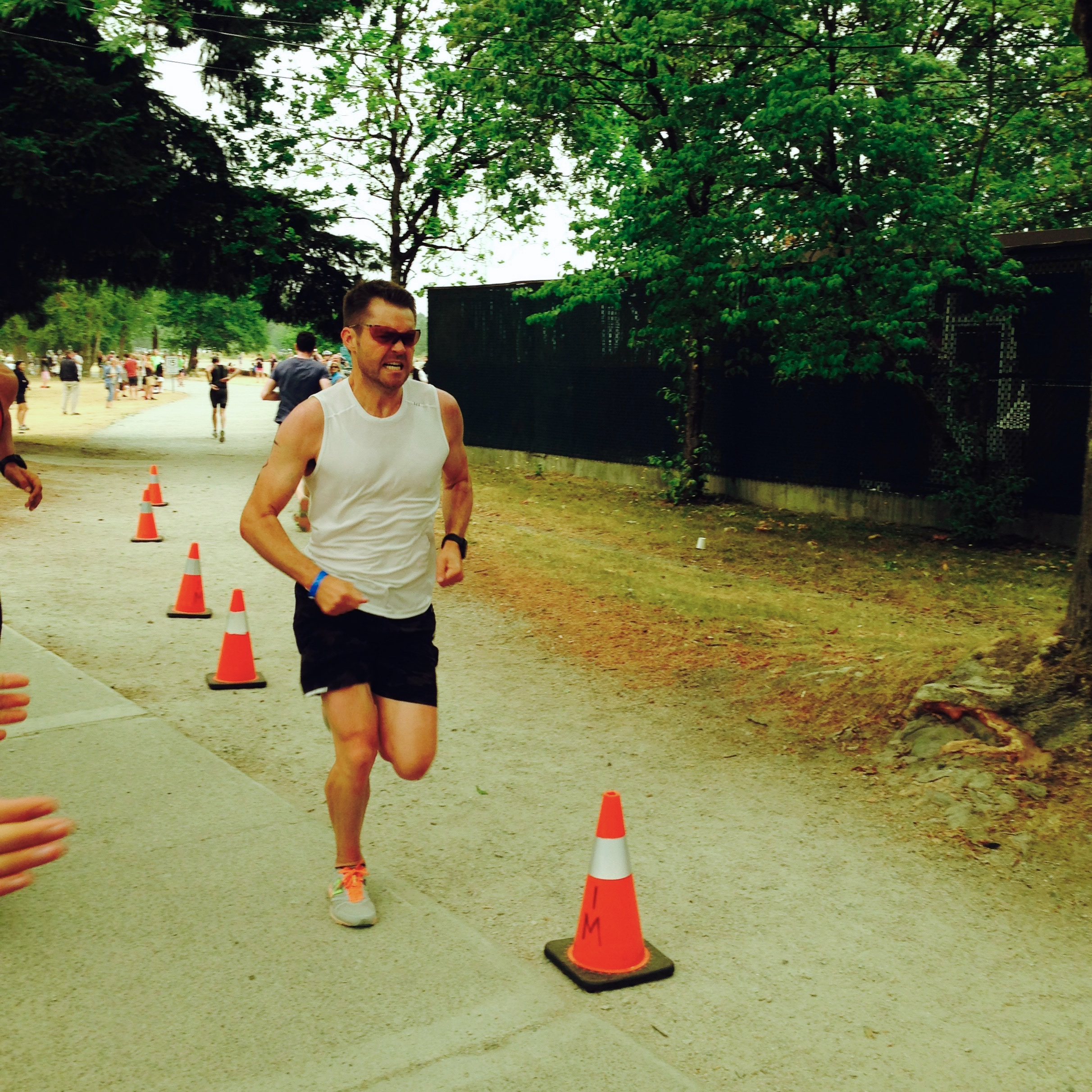 Tom running with grit at the Subaru Vancouver Triathlon