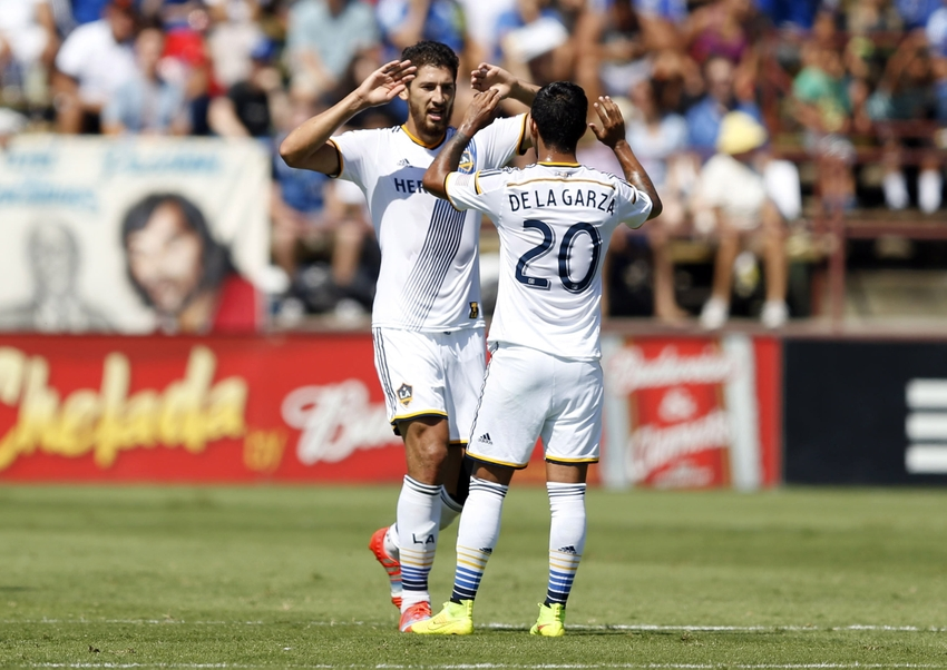 Sep 14, 2014; Santa Clara, CA, USA; Los Angeles Galaxy defender Omar Gonzalez (4) celebrates with Galaxy defender A.J. DeLaGarza (20) after Gonzalez scored a goal during the first half against the San Jose Earthquakes  at Buck Shaw Stadium. Mandatory Credit: Bob Stanton-USA TODAY Sports