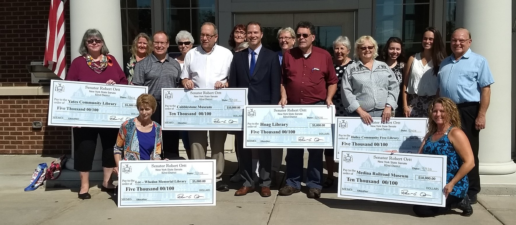 NY Senator Robert Ortt presented several Orleans county organizations (including the Community Free Library) with ceremonial grant checks at the Hoag Library on September 4, 2018