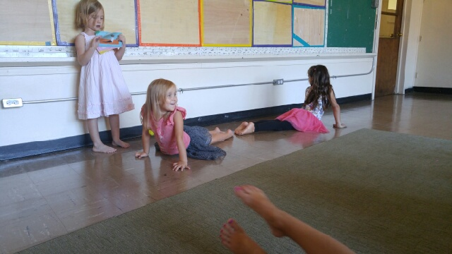 Aidan, Gabby, and Adalaide show a sequence of poses they created