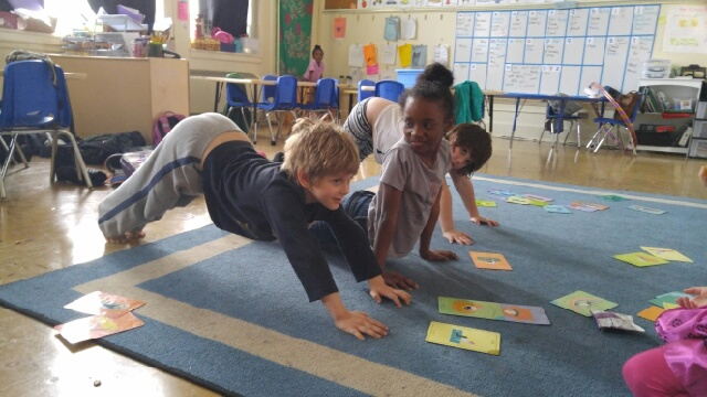 Peregrine, Juana, and EllyMae practice yoga afterschool at Bricolage