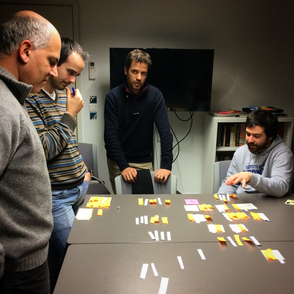 Co-founder Paiva, Head of Product Tiago Moreiras, With Company's Tiago Nunes and Landing.jobs co-founder Pedro Oliveira survey the surviving scraps of paper.