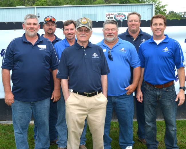 """Front/Center - H.B Kenyon - President  From Right to Left:W. Blake Andrews - Vice President,Gary """"Bulldog"""" Martindale - General Superintendent,Jeff J. Comeaux - General Superintendent,Mike A. Tassin - General Superintendent,Robbie Whitaker - Superintendent,David A. Wenk - General Superintendent"""