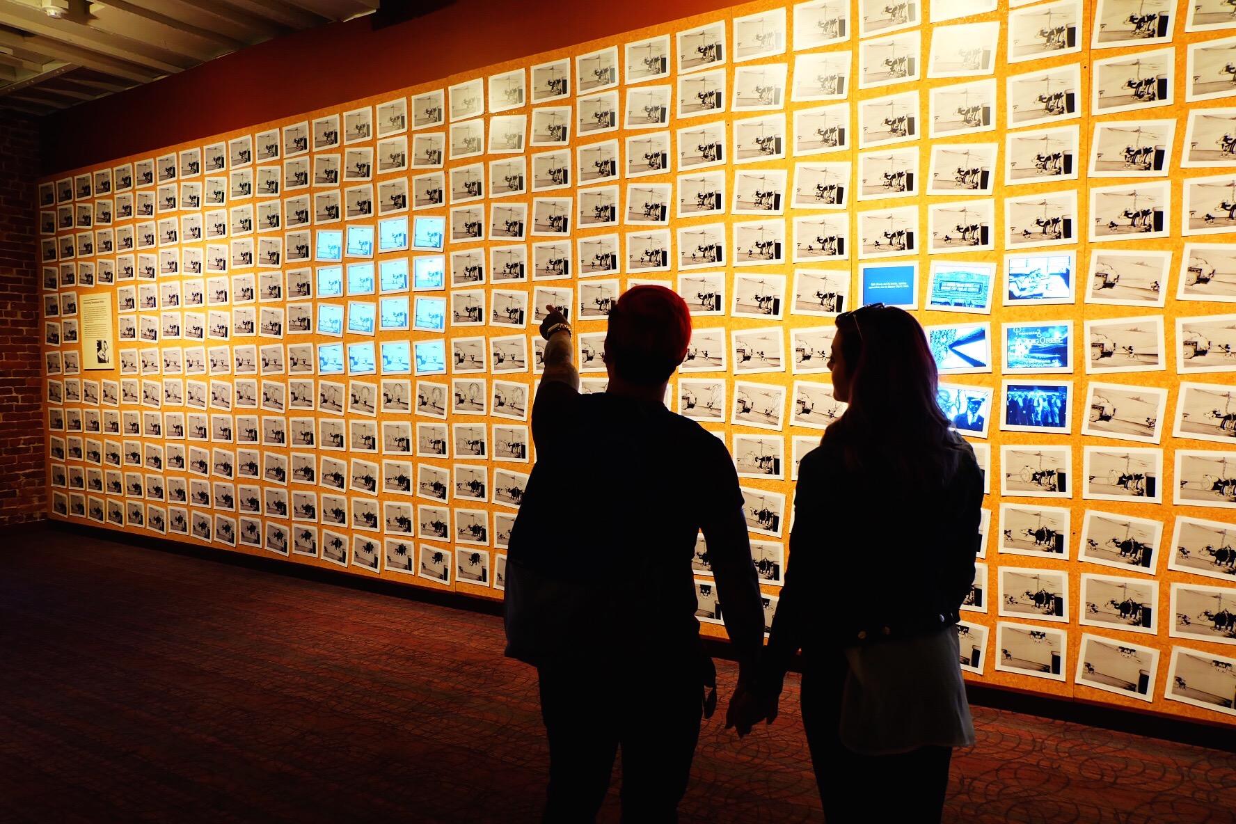 Steamboat Willie stills illuminated across an entire wall.